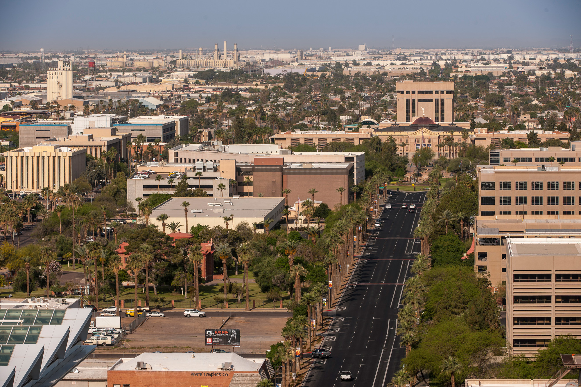 """Arizona's """"Centennial Way"""", honors Arizona's 100 years of statehood by transforming the imperative roadway with wider sidewalks and crosswalks, enhanced street and pedestrian lighting, as well as benches, canopies, and displays that feature historical and cultural information about Arizona's counties."""