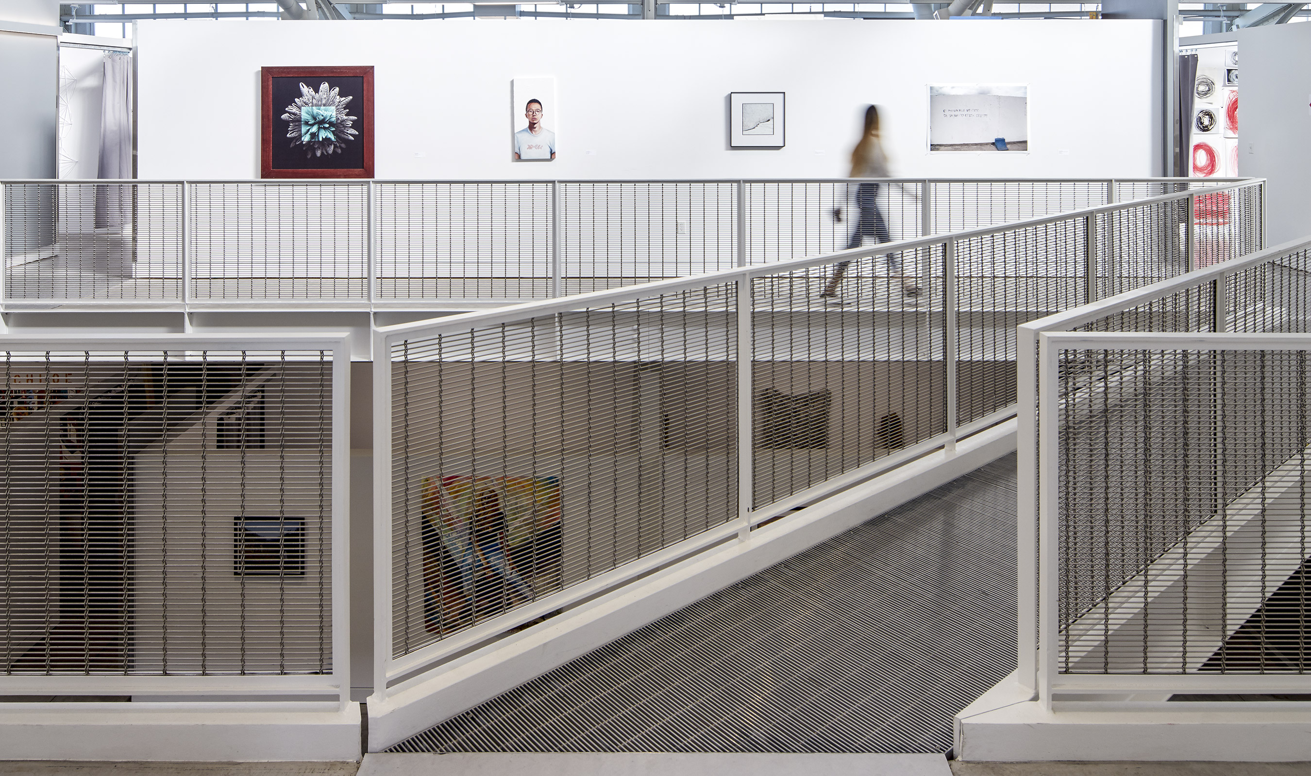 """The simplistic look of M13Z-145 allows the mesh to """"disappear"""", allowing the artwork to stand out on the white walls."""