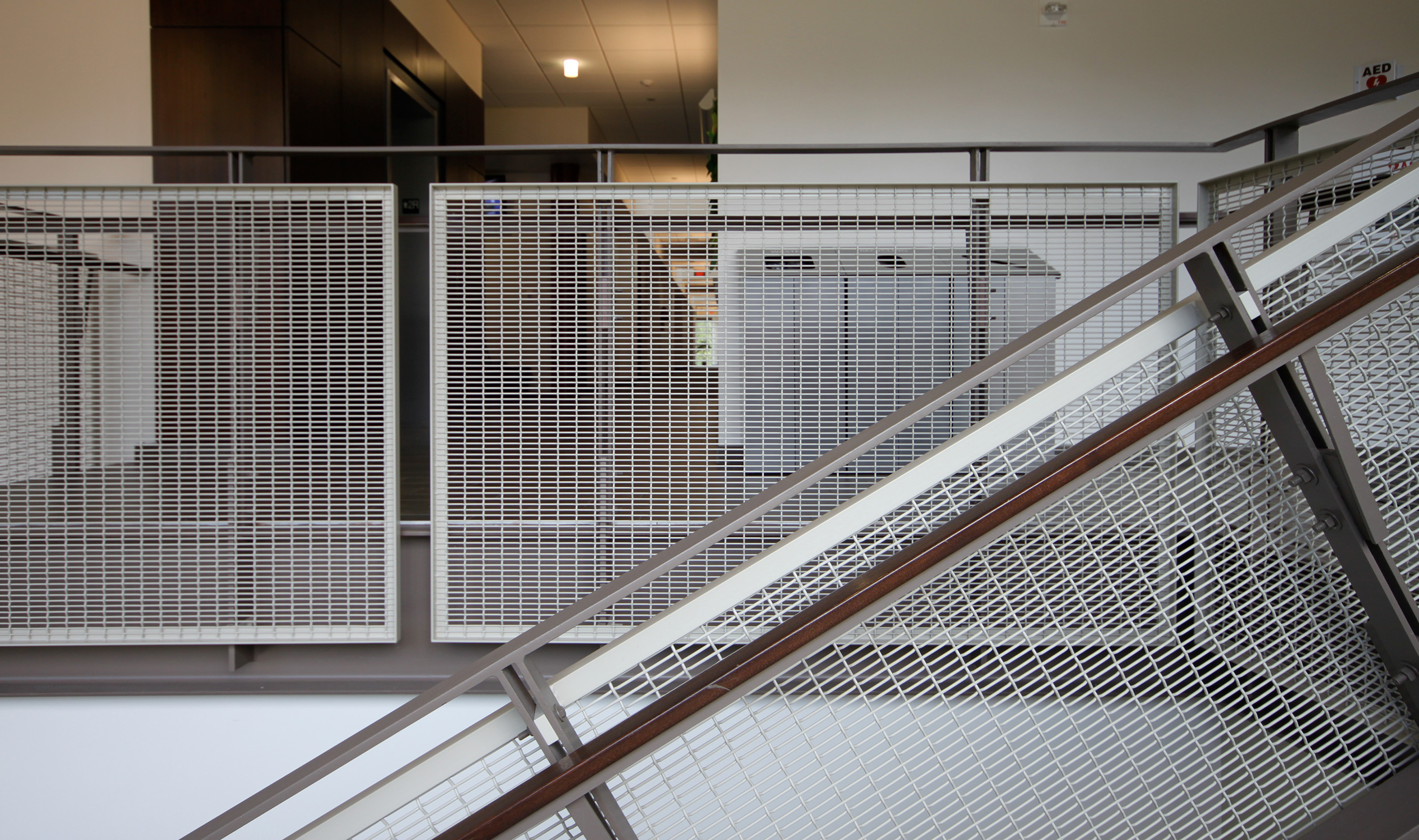 FPZ-16 wire mesh panel framed in angle iron and given white powder coat finish.