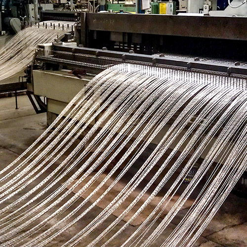 an image of our loom, crafting a woven wire mesh