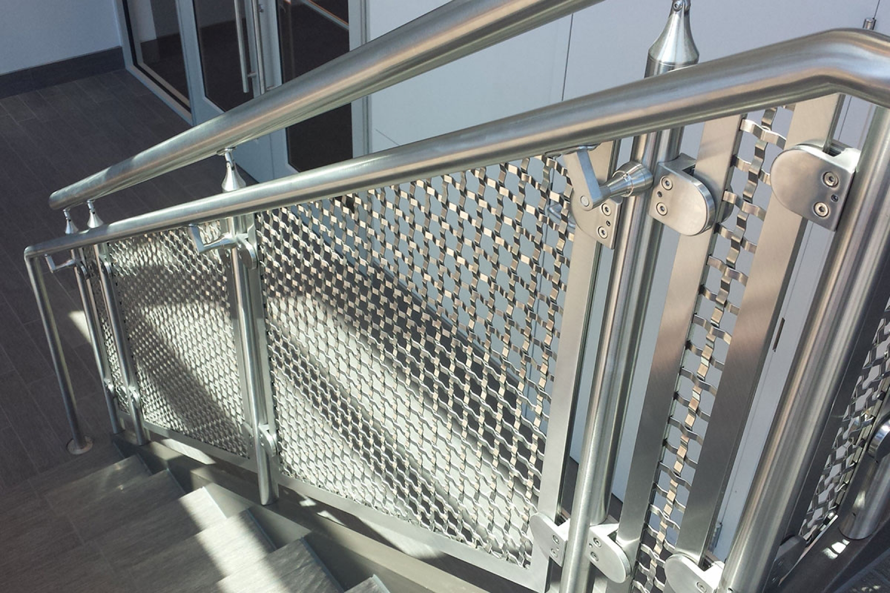 The decorative mesh S-15 used as railing infill in this PNC Bank allows for ample amounts of light to enter the lobby.