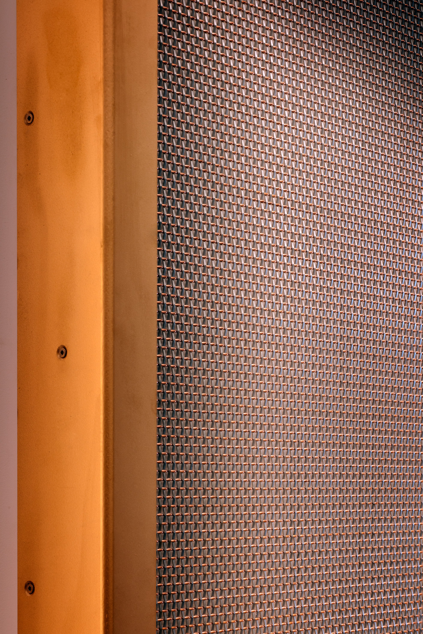 The copper and stainless steel SZ-4 was mounted to the wall by trapping it behind a sheet of glass and a custom manufactured frame.