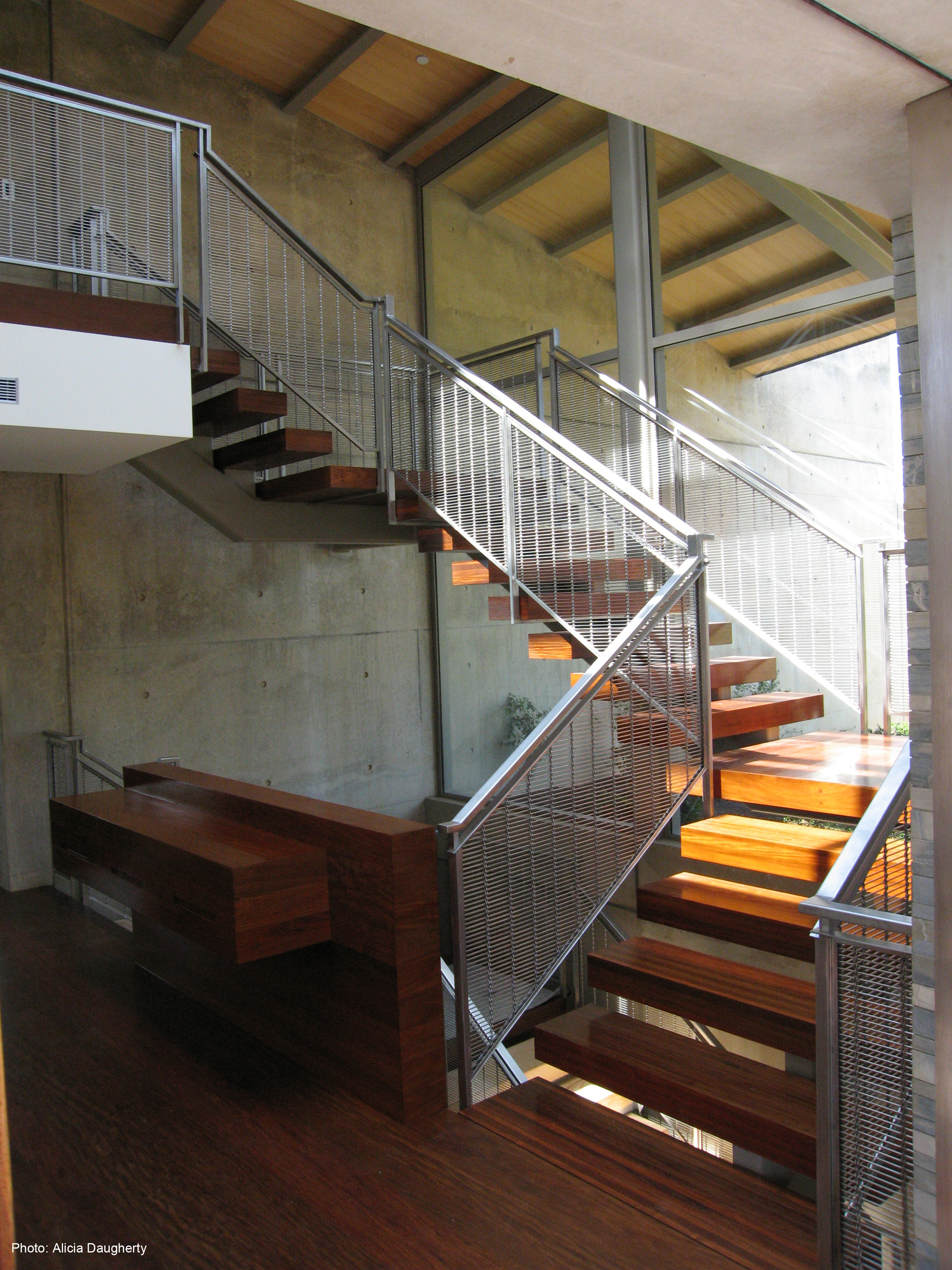 M13Z-145 Rigid Cable wire mesh is an essential element of this grand staircase design.