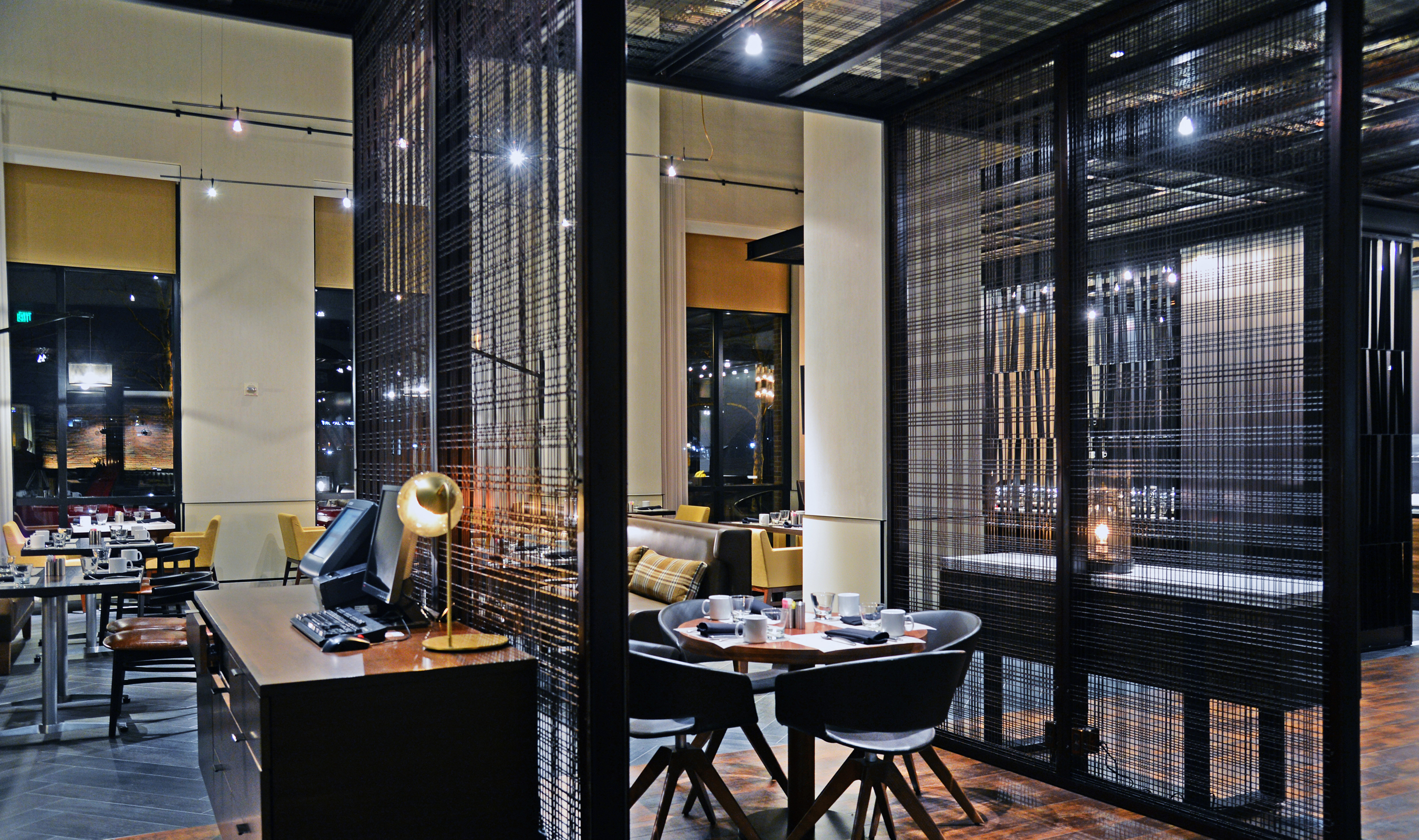 """Banker Wire  mesh""""pavilions"""" divide this restaurant space."""