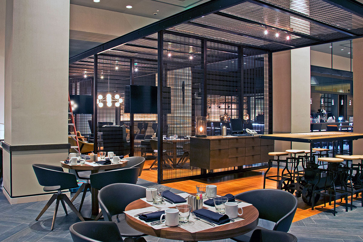 The color coating and the M44-2 weave evoke cane or bamboo and play off a decorative cabana and other wooden design elements throughout the restaurant space.