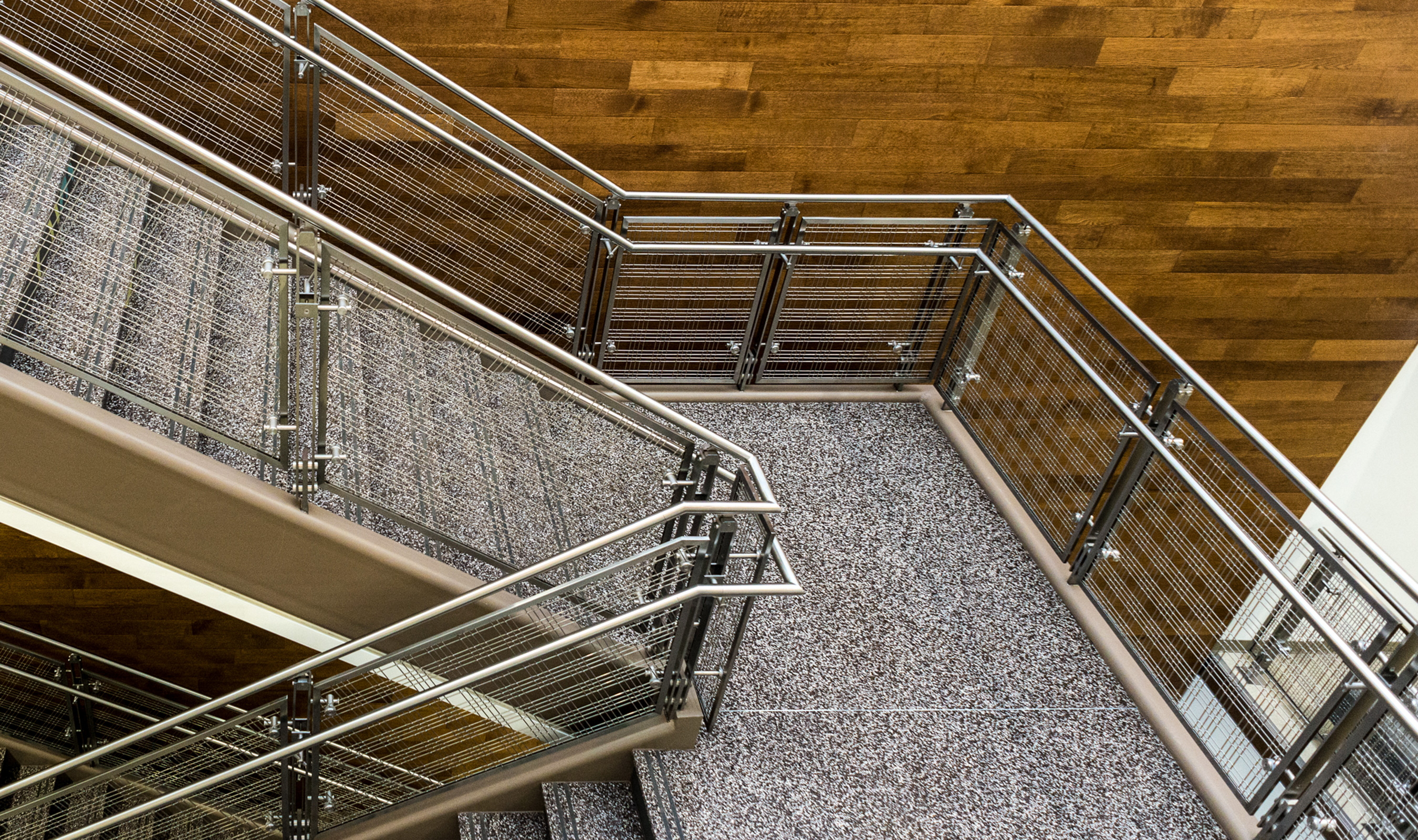 Durability is paramount in high traffic college campus hallways. Banker Wire mesh as railing infill panels are as functional as they are beautiful.