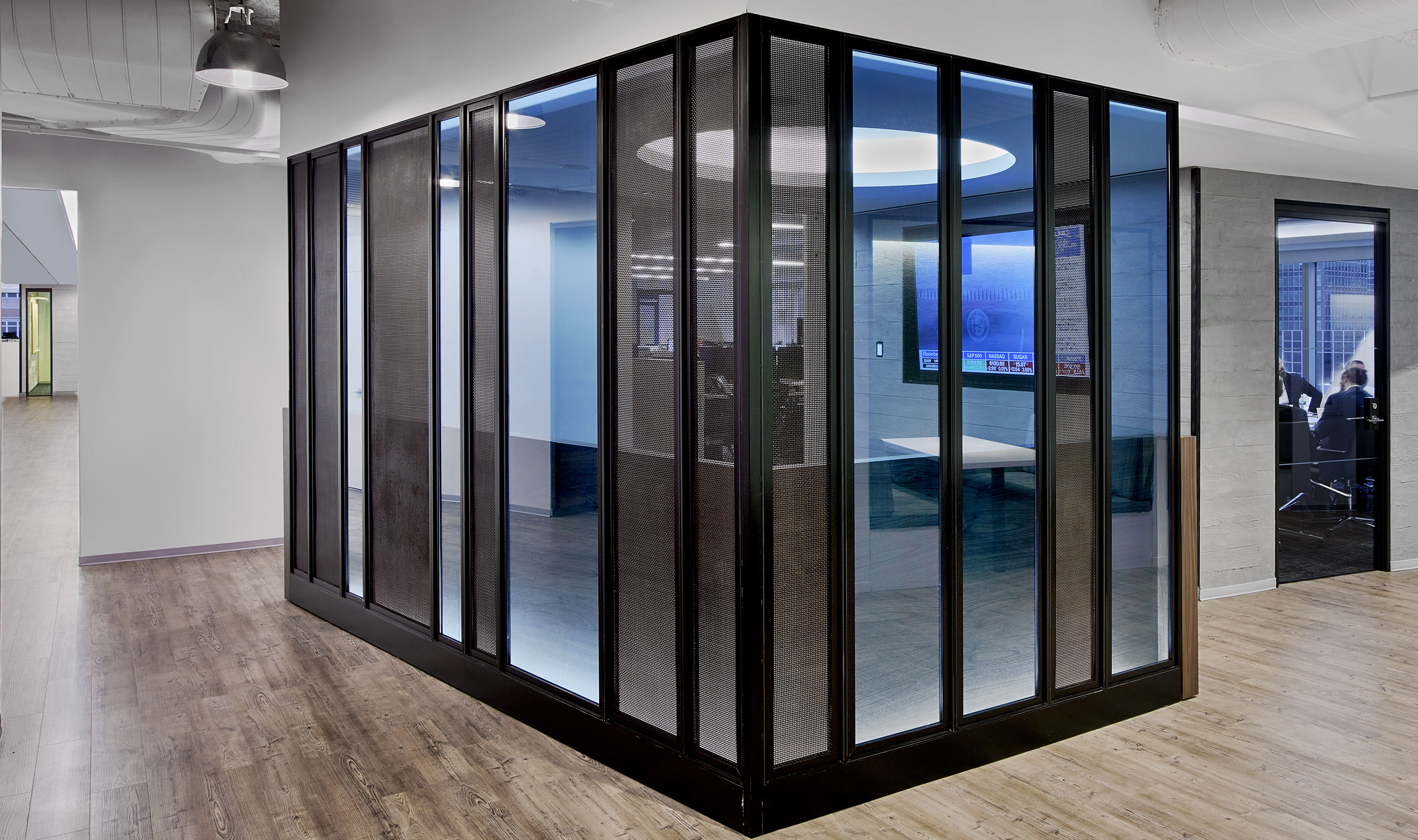 Banker Wire's S-12 mesh pattern creates a division in this large space while maintaining a sense of openess.