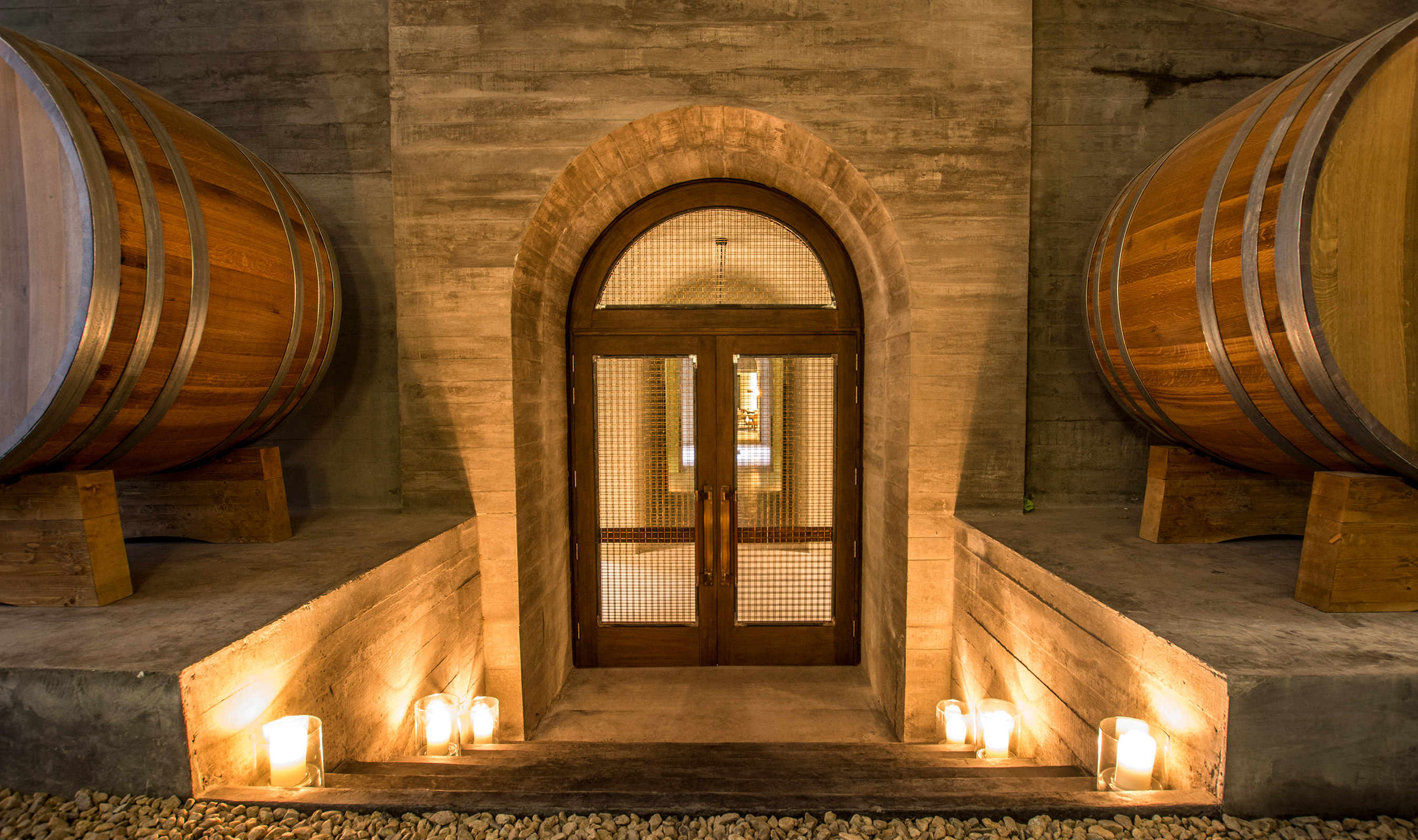 Woven wire mesh is an economical and beautiful choice as infill for this stunning set of doors in the Bodega Garzon Winery