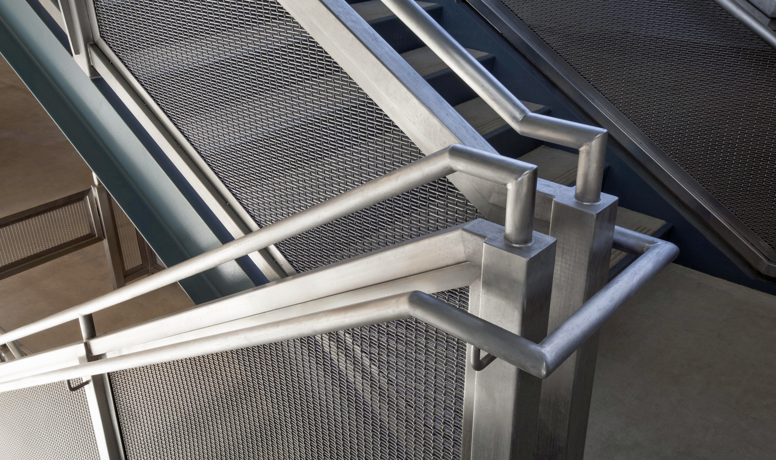 On the garage's staircases, walkways and pedestrian bridge, Banker Wire FPZ-10 woven wire mesh provides durability, fall protection and a unique look.