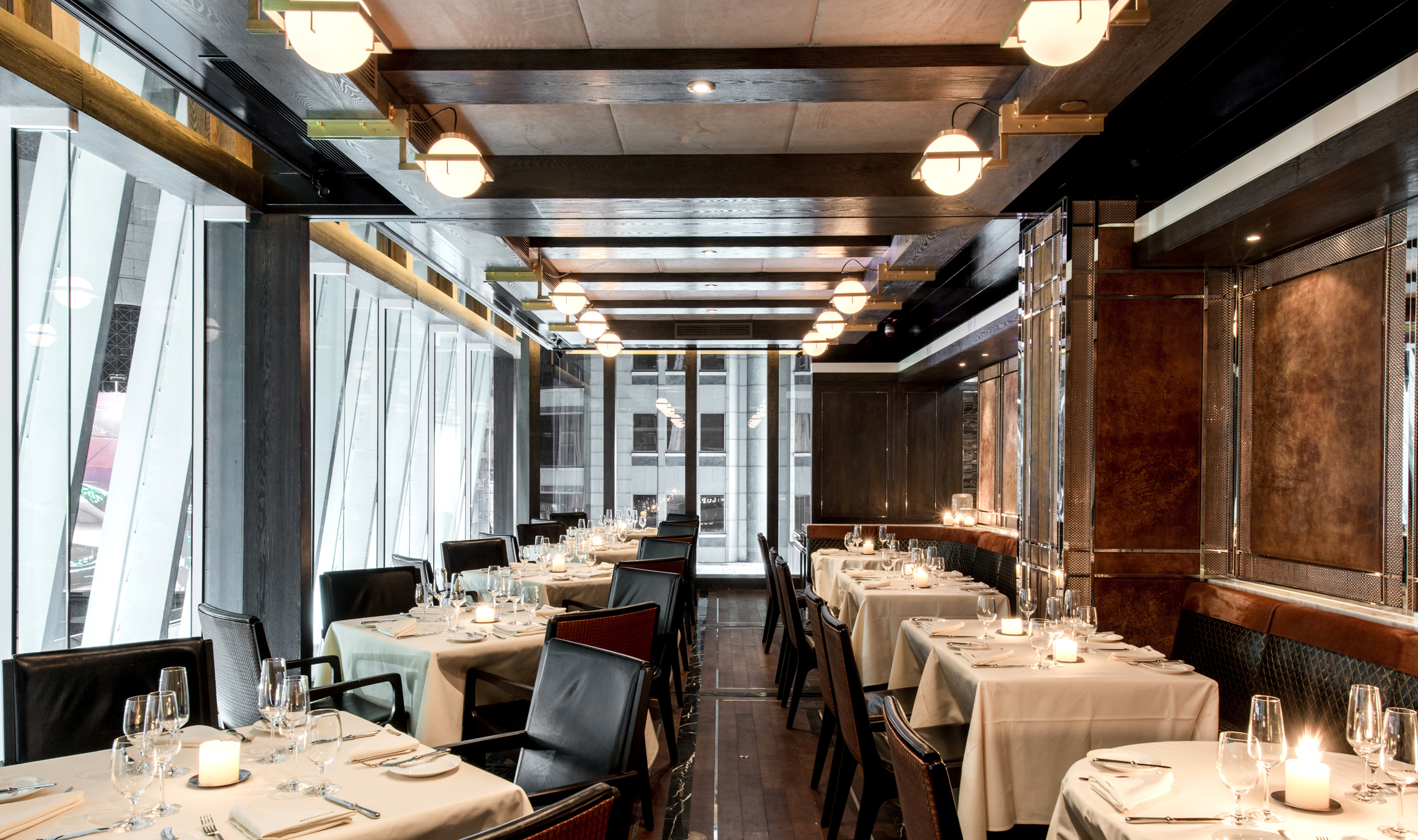 Banker Wire mesh was used in the restaurant's wine cellar, dining room and private dining area as a background accent for stone, metal and leather paneling.