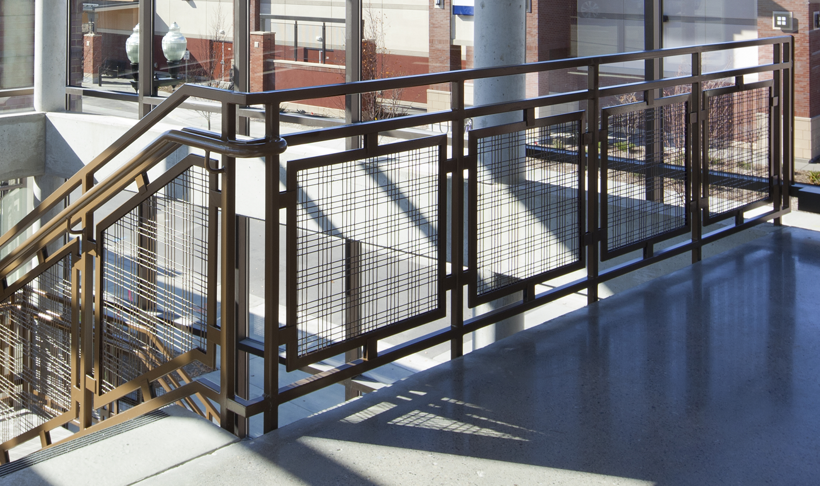 Powder-coated M44-2 woven wire mesh is used as infill panels for the interior railing.