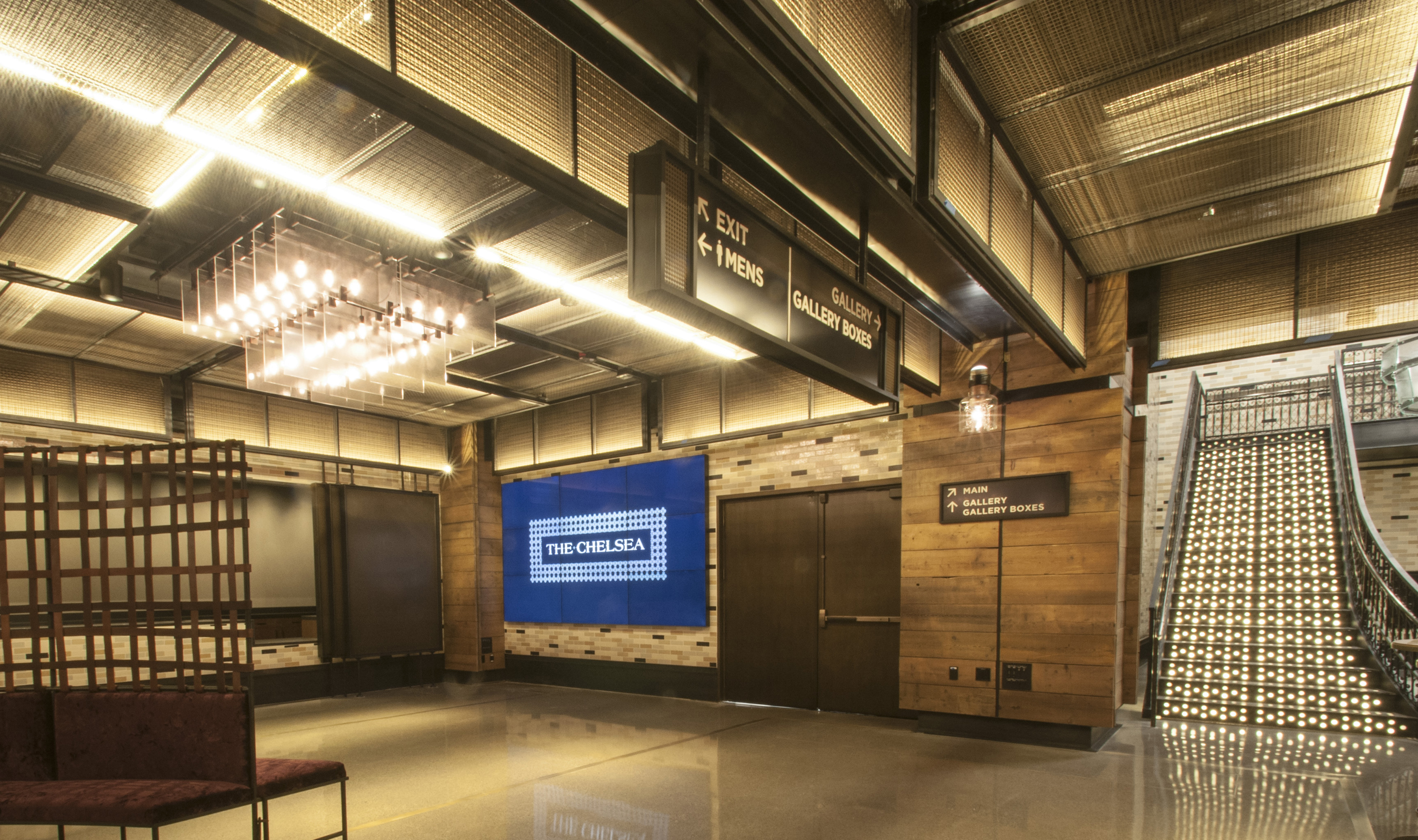 Banker Wire M22-28 and L-81 woven wire mesh patterns were used as a custom ceiling and wall panel design located throughout the lounge and theater spaces.