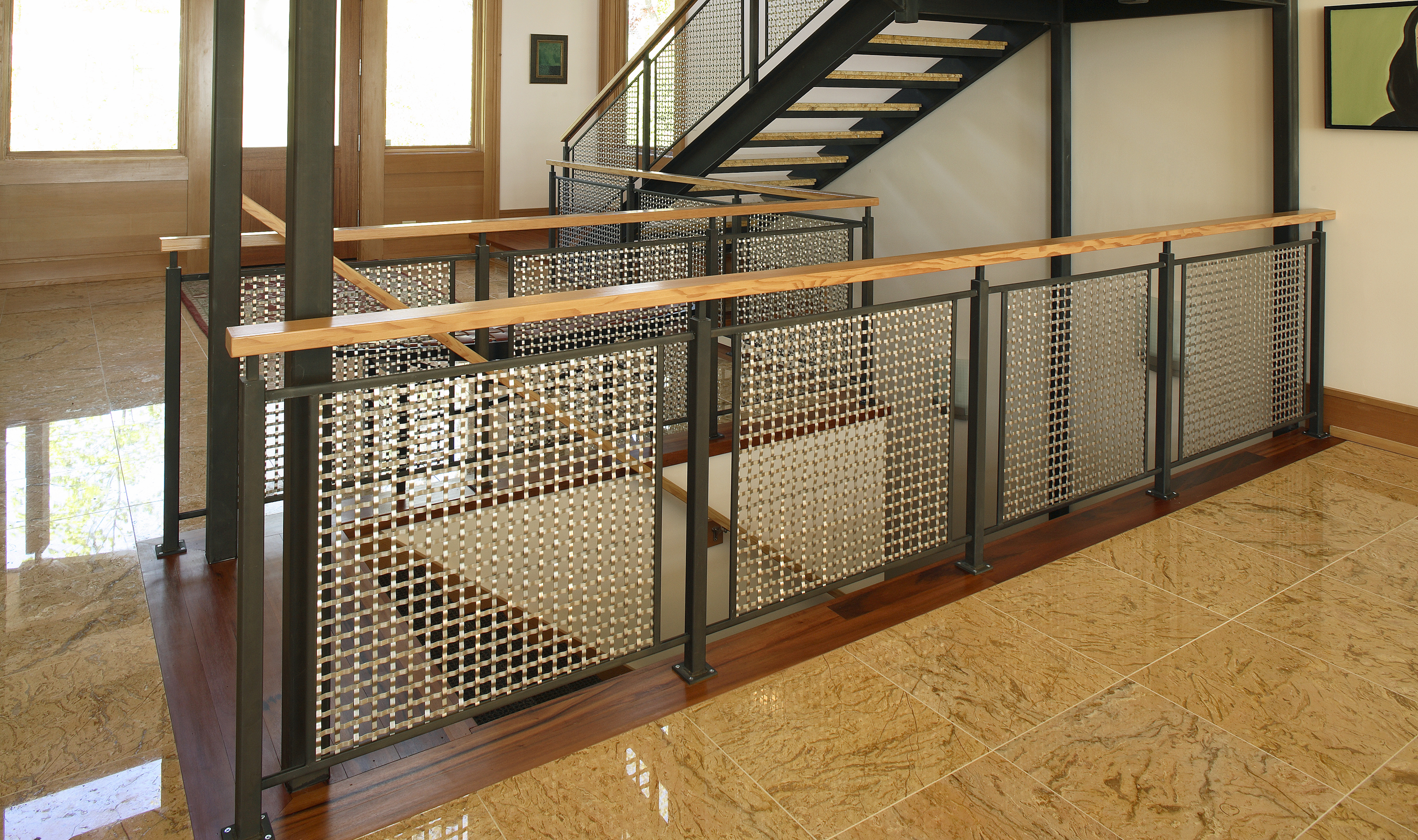 S-15 flat woven wire mesh captures and reflects light in this contemporary home.
