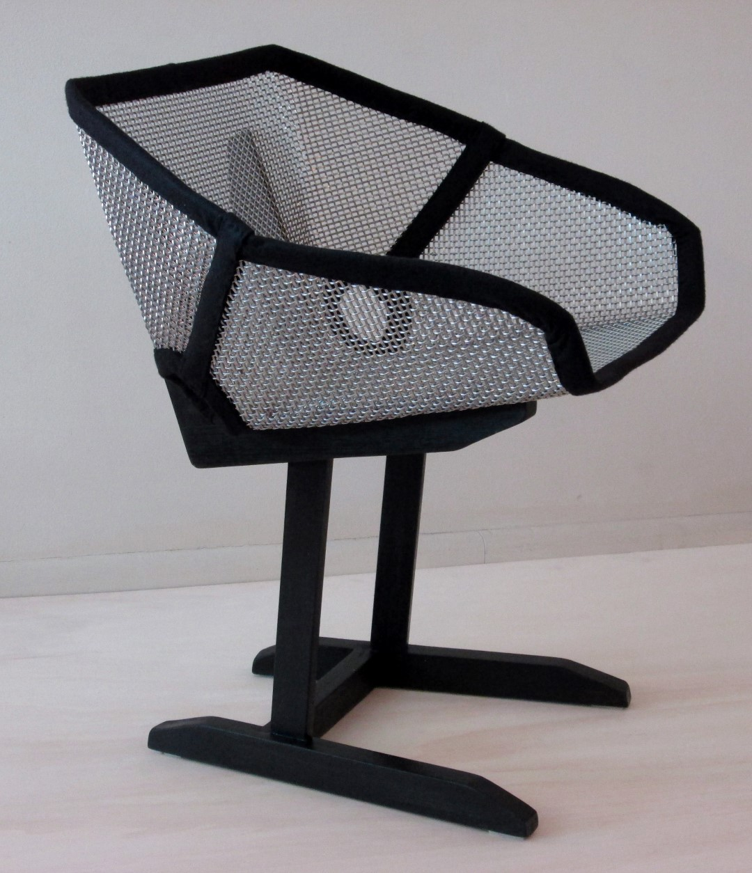 SZ-4 provides interesting reflective characteristics to this chair.