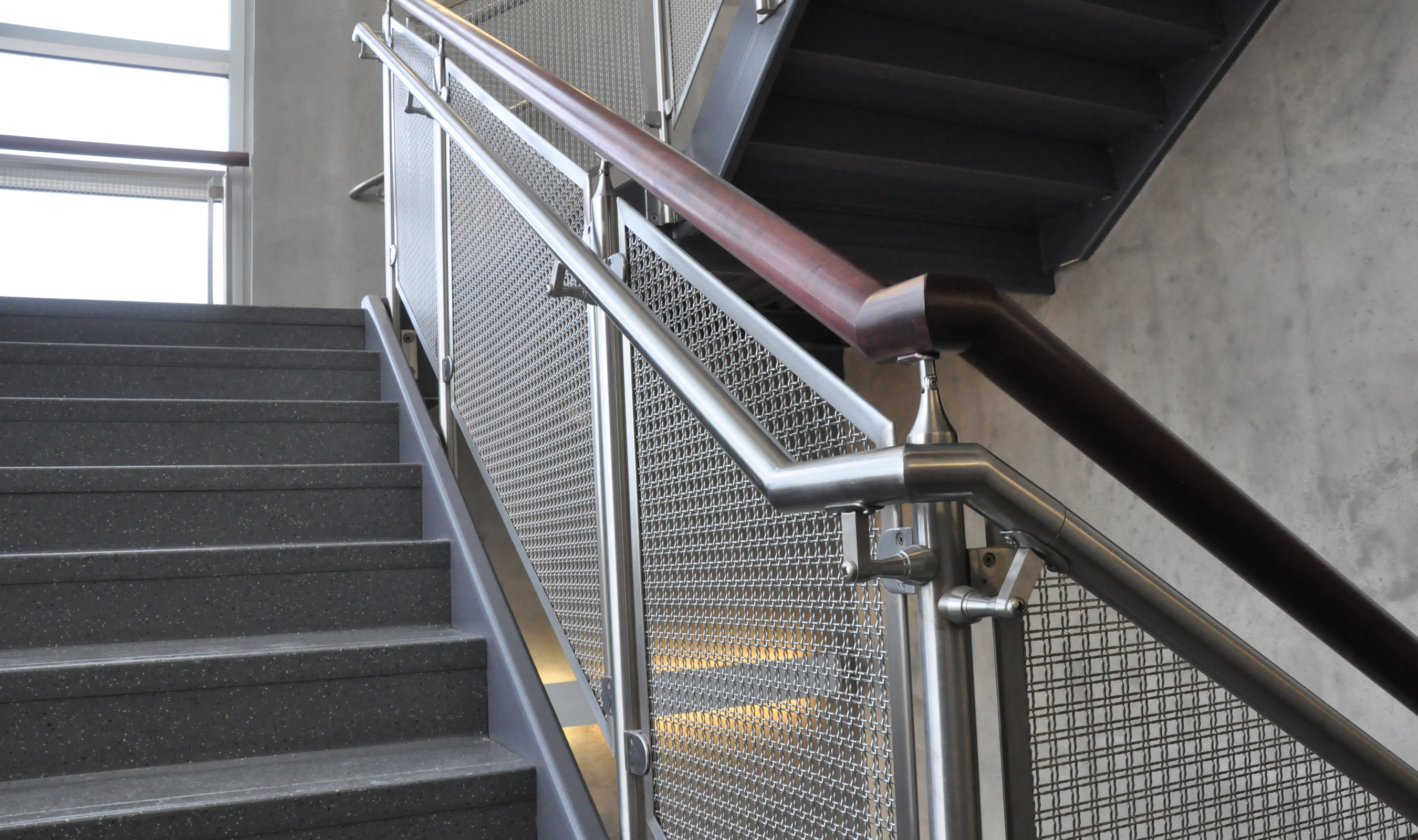 The openness of the stainless steel wire mesh railing infill panels keeps the space well lit by the outside light coming in.