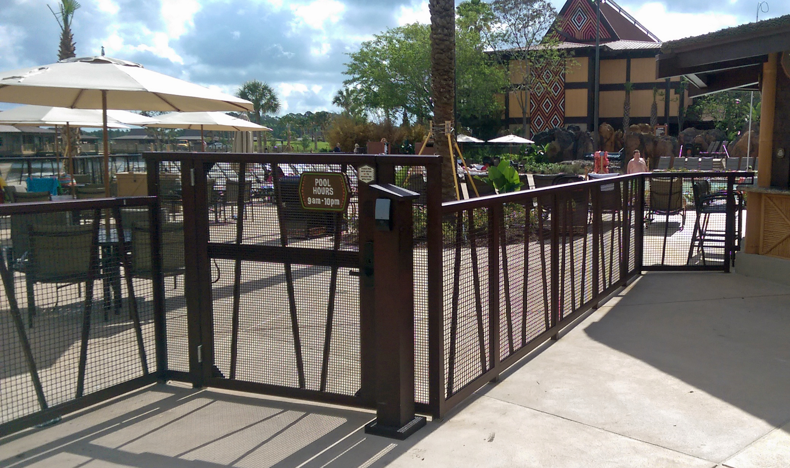 Powder coated Banker Wire mesh blends in with the colors of this resort.