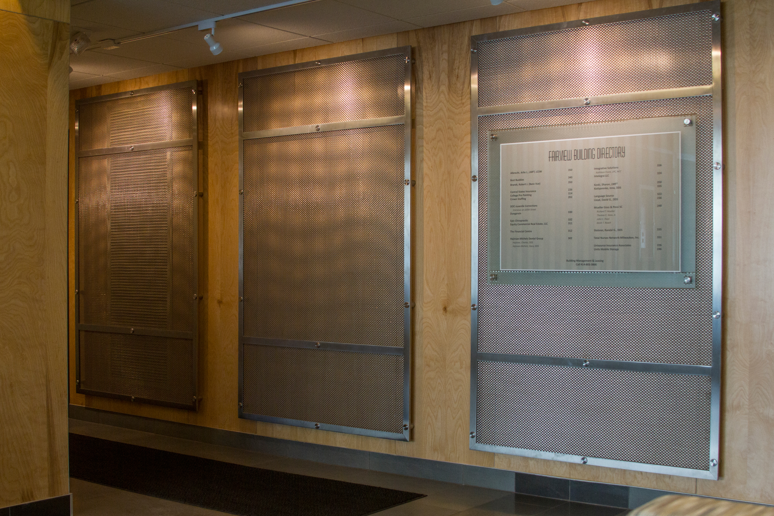 SZ-4 woven wire mesh pattern in stainless steel, framed by the Versatile Spine, fits the requirement of this project.