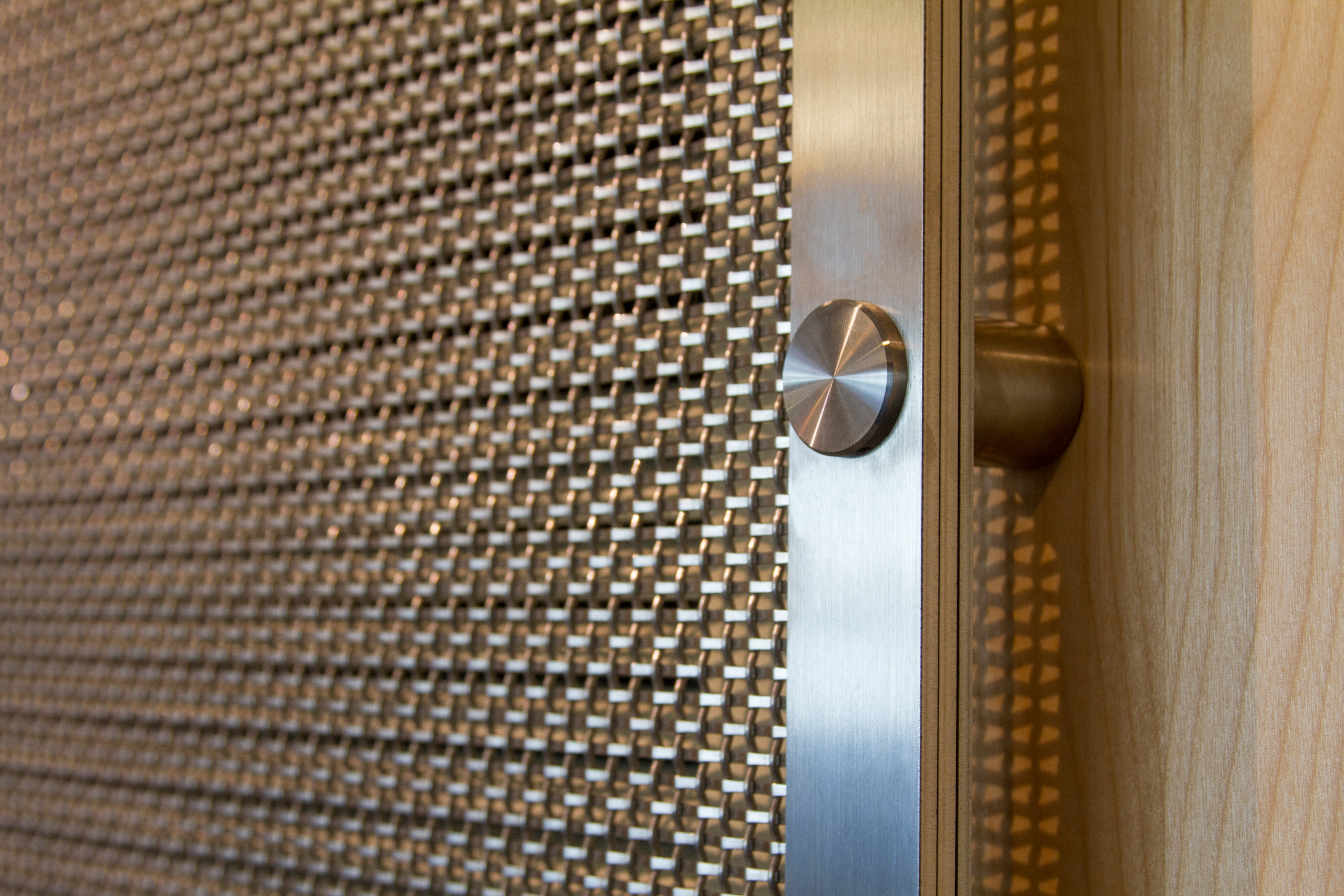 The panels utilize stainless steel standoff mounting hardware with decorative caps.