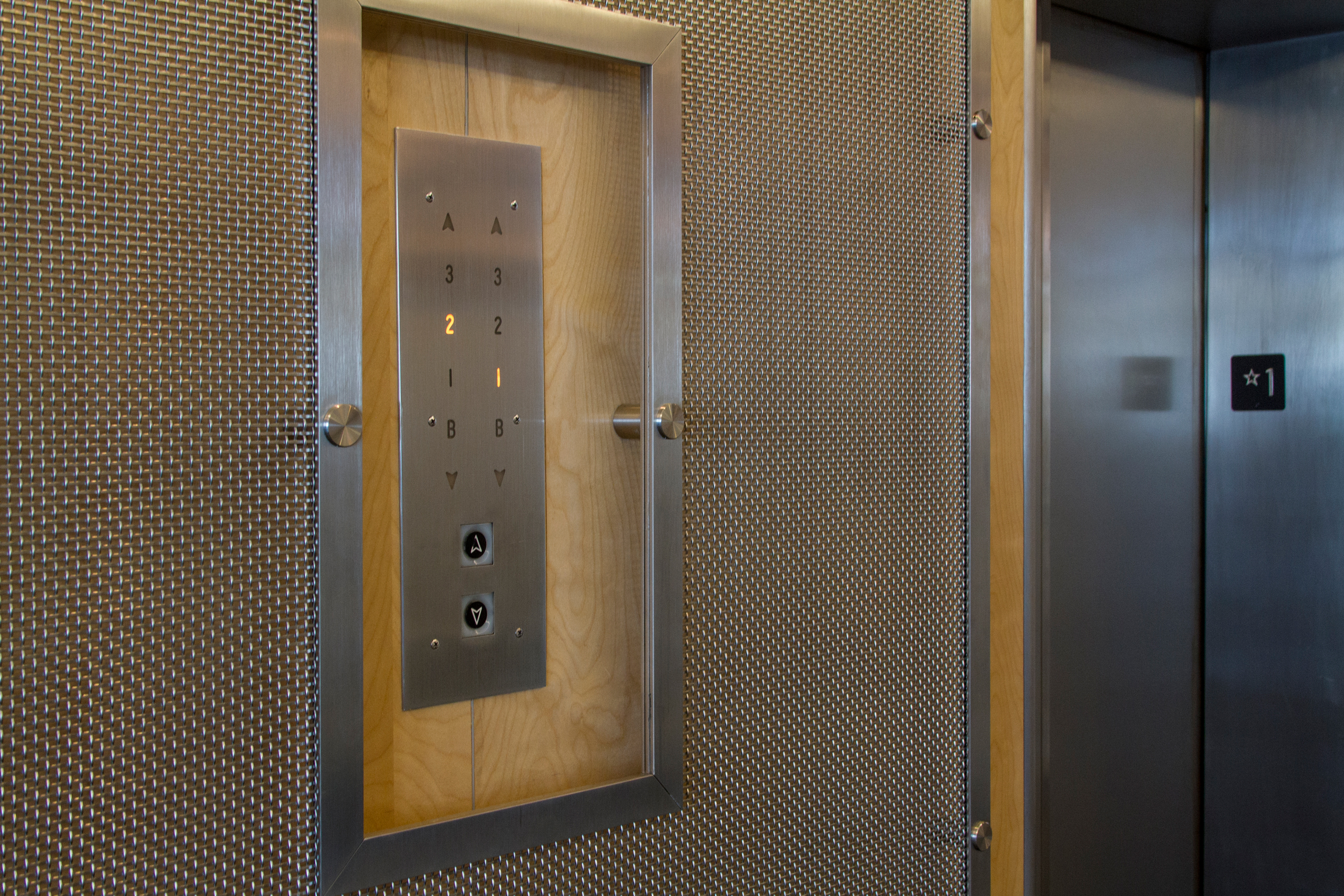 Cut outs in the Banker Wire mesh provide access to the elevator buttons.