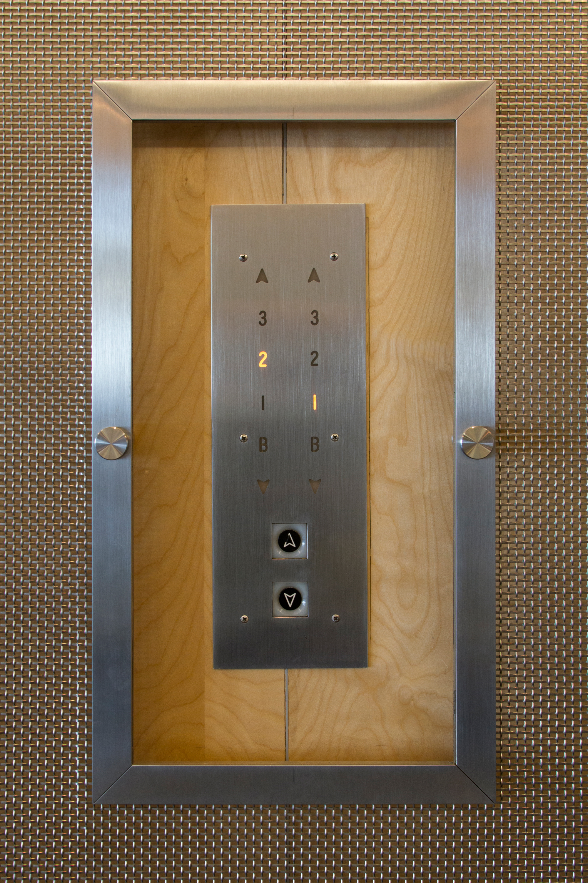 Five panels were created, one of which has a cut out to provide access to the elevator buttons.