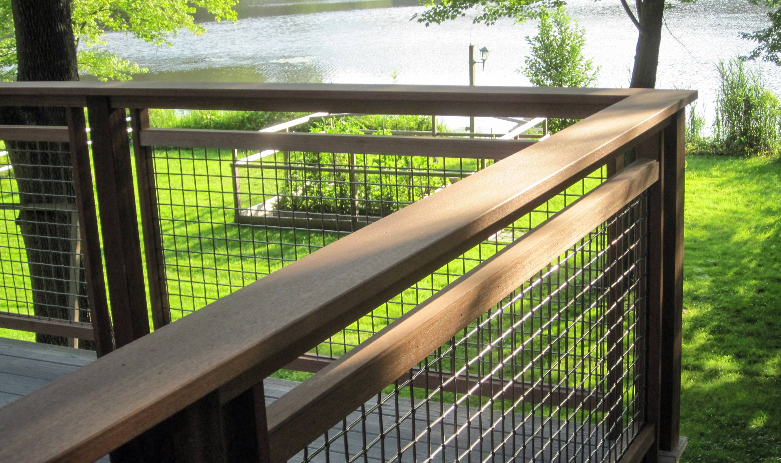 L-62 woven wire mesh is a sturdy mesh to use as railing infill for this back yard deck.
