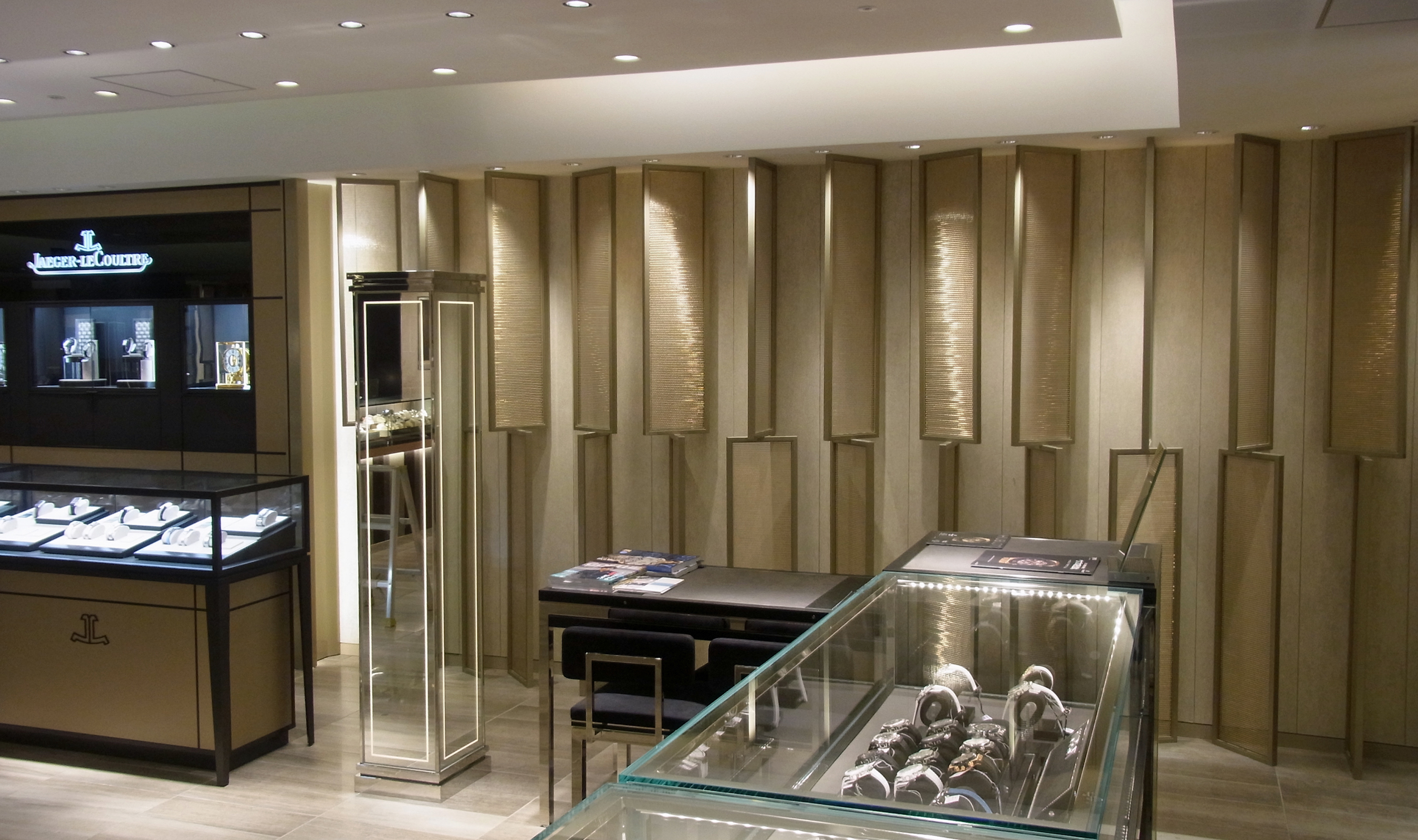 Light cascading from above highlights the Banker Wire mesh used in this retail space.