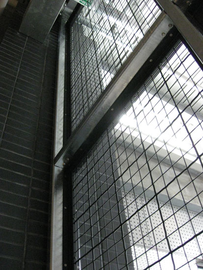 Banker Wire mesh is secured with a customized angle iron frame.