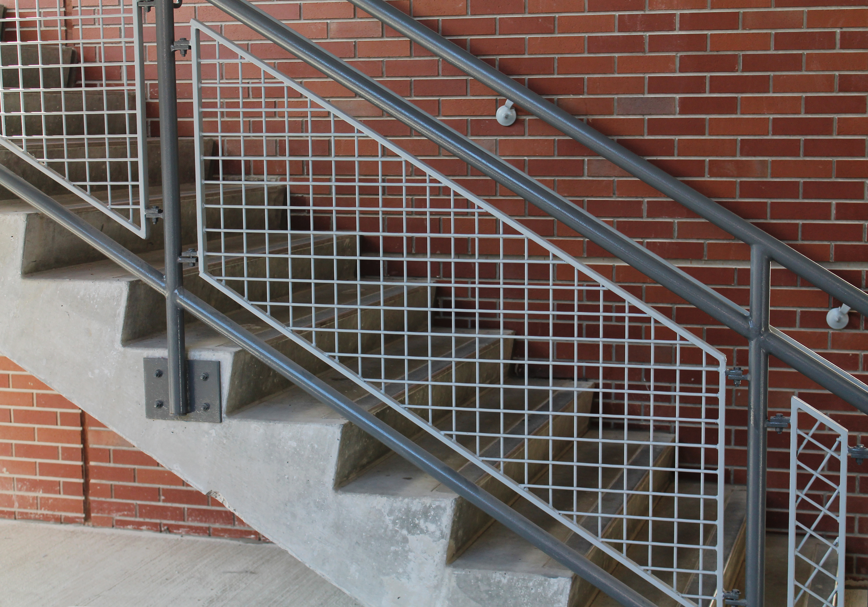 Mesh was used in railing infill panels, as well as in the facade and signage backgrounds.