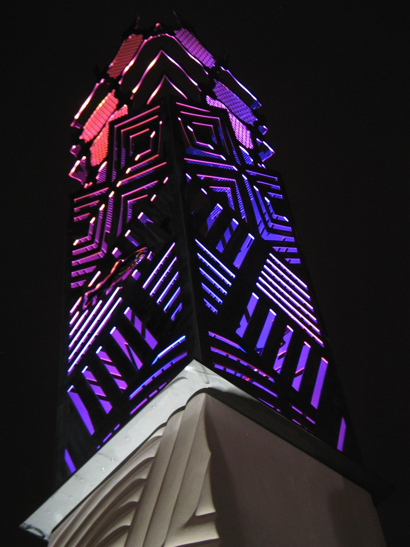 Color-changing LED fixtures light up this installation at night.