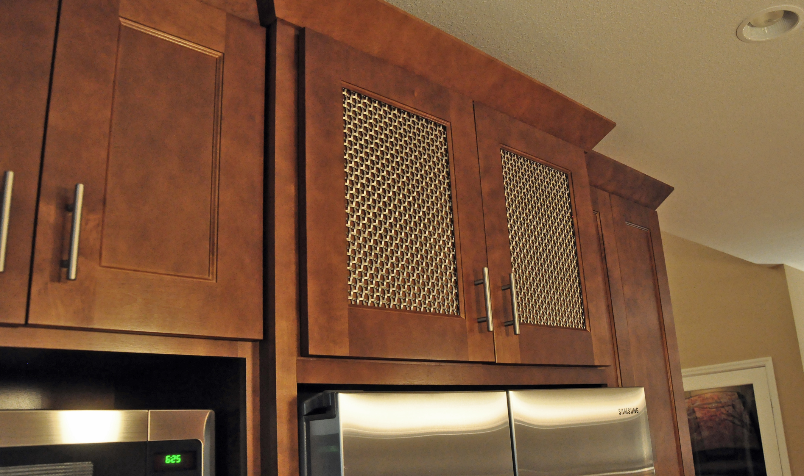 Stainless steel mesh carries a silvery accent throughout this space.