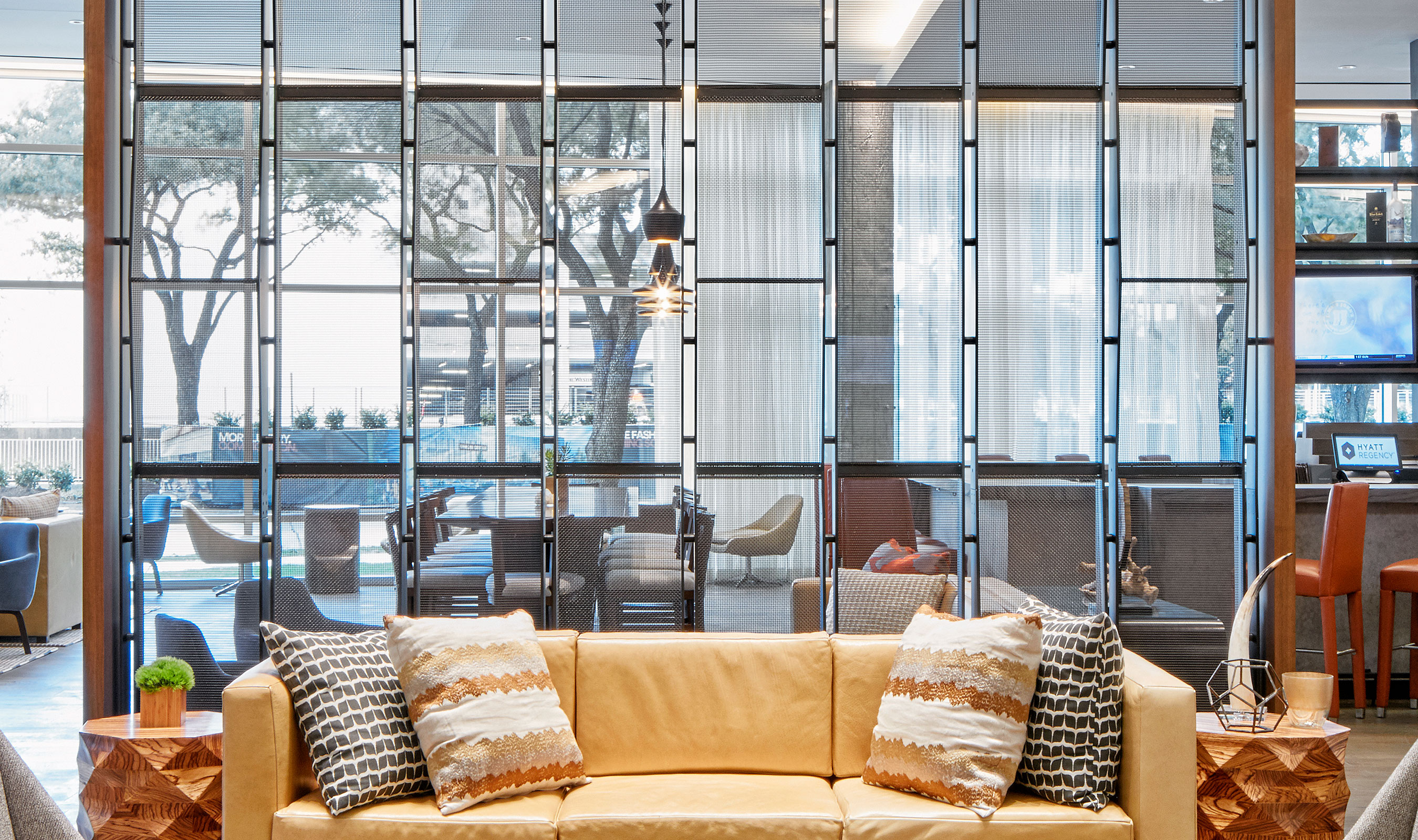 Banker Wire's IPZ-25 and P-282 are used as a stunning space divider in the lobby of the Hyatt Regency Houston Galleria.