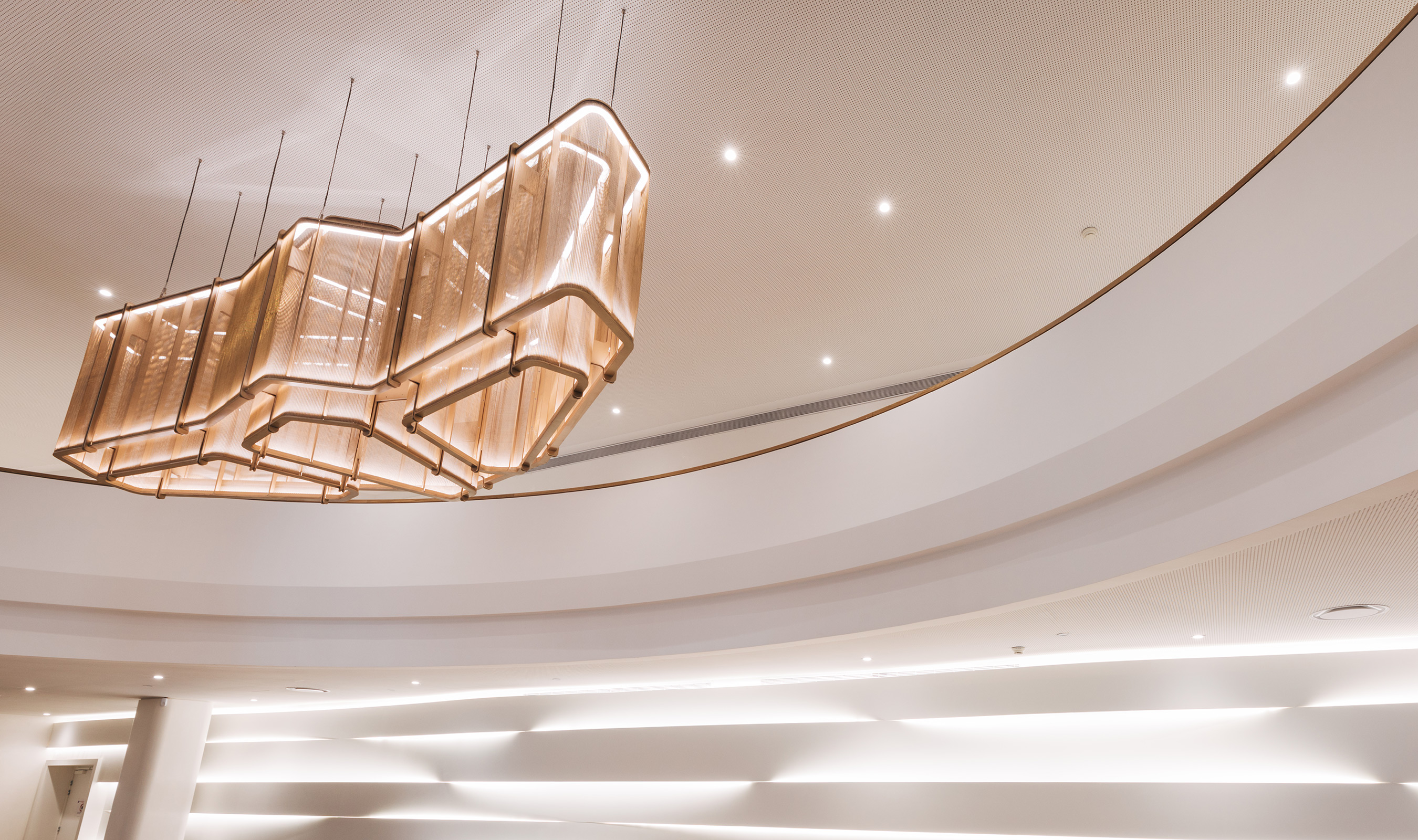 The layers of mesh create an intiriquing pattern for the custom chandelier.