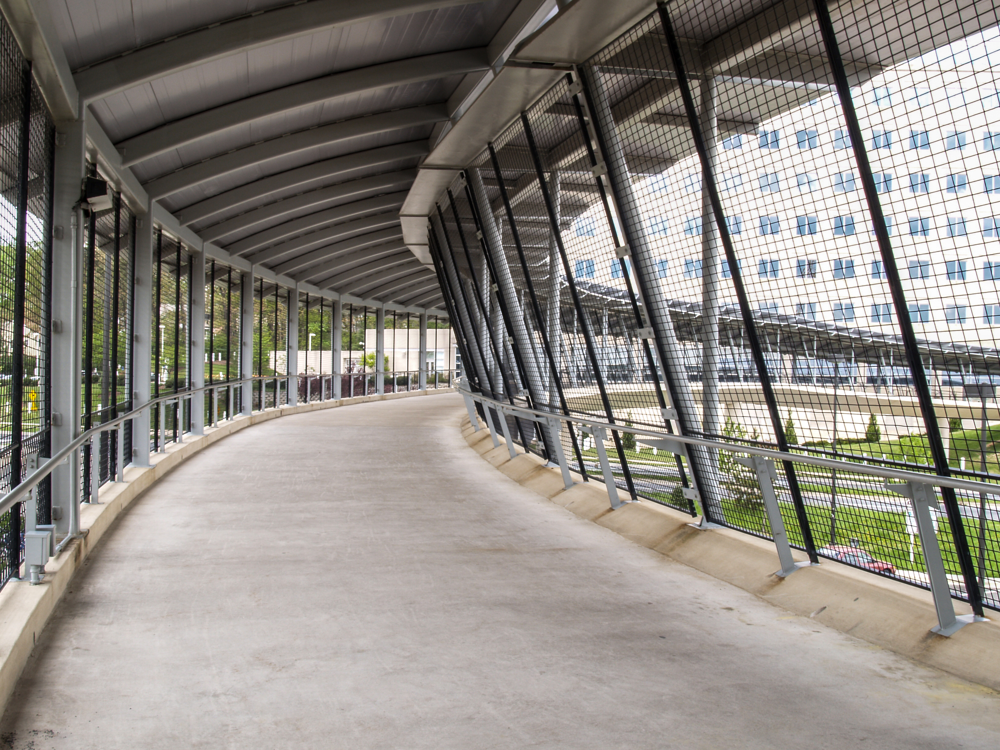 Inside the IRS Building Walkway, Banker Wire mesh serves as an attractive alternative to chainlink fencing.