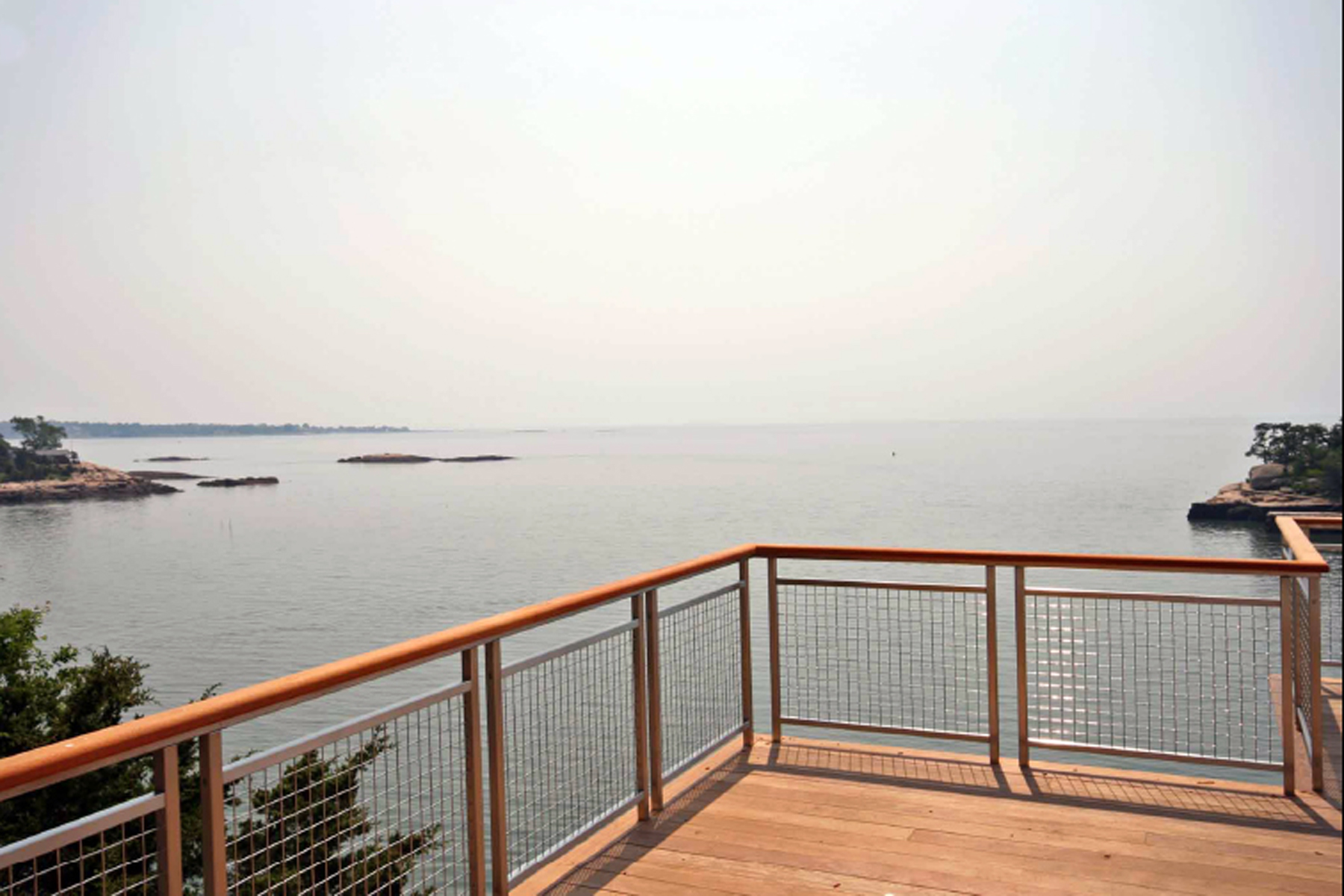 The elegance of the L-62 woven wire mesh does not take away from nature's beauty on this deck.