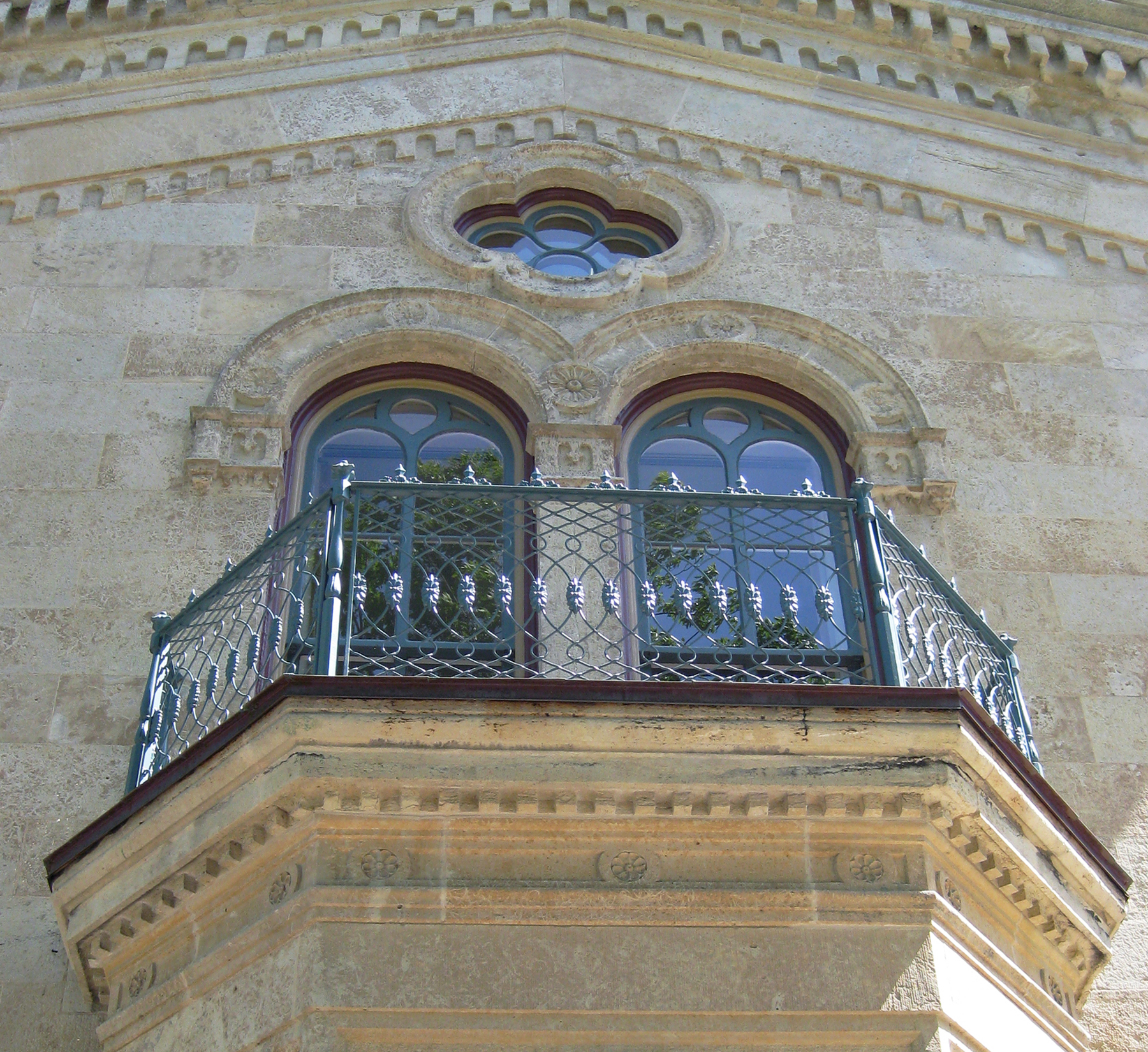 The restored pattern now sits again where it has for more than a century – atop the balcony over the inn's front entrance.