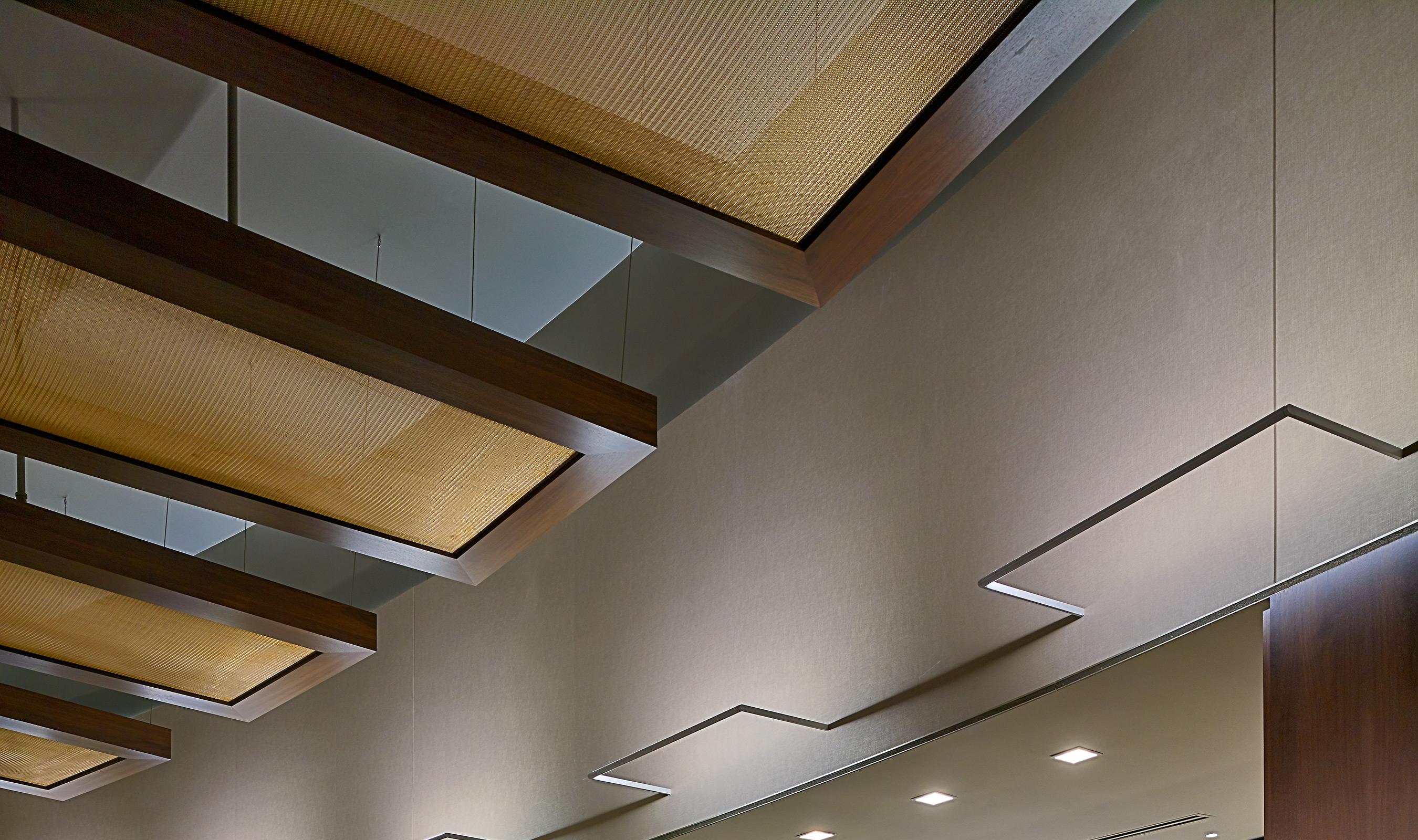 Bronze ceiling clouds framed with dark wood surround