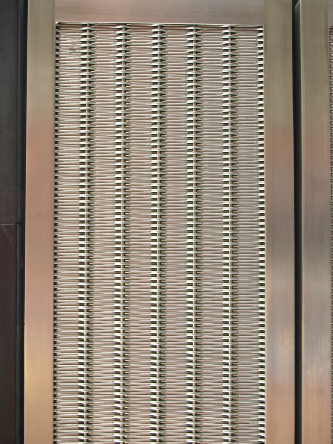 This woven wire mesh pattern was created specifically for the Montgomery Park office building project.