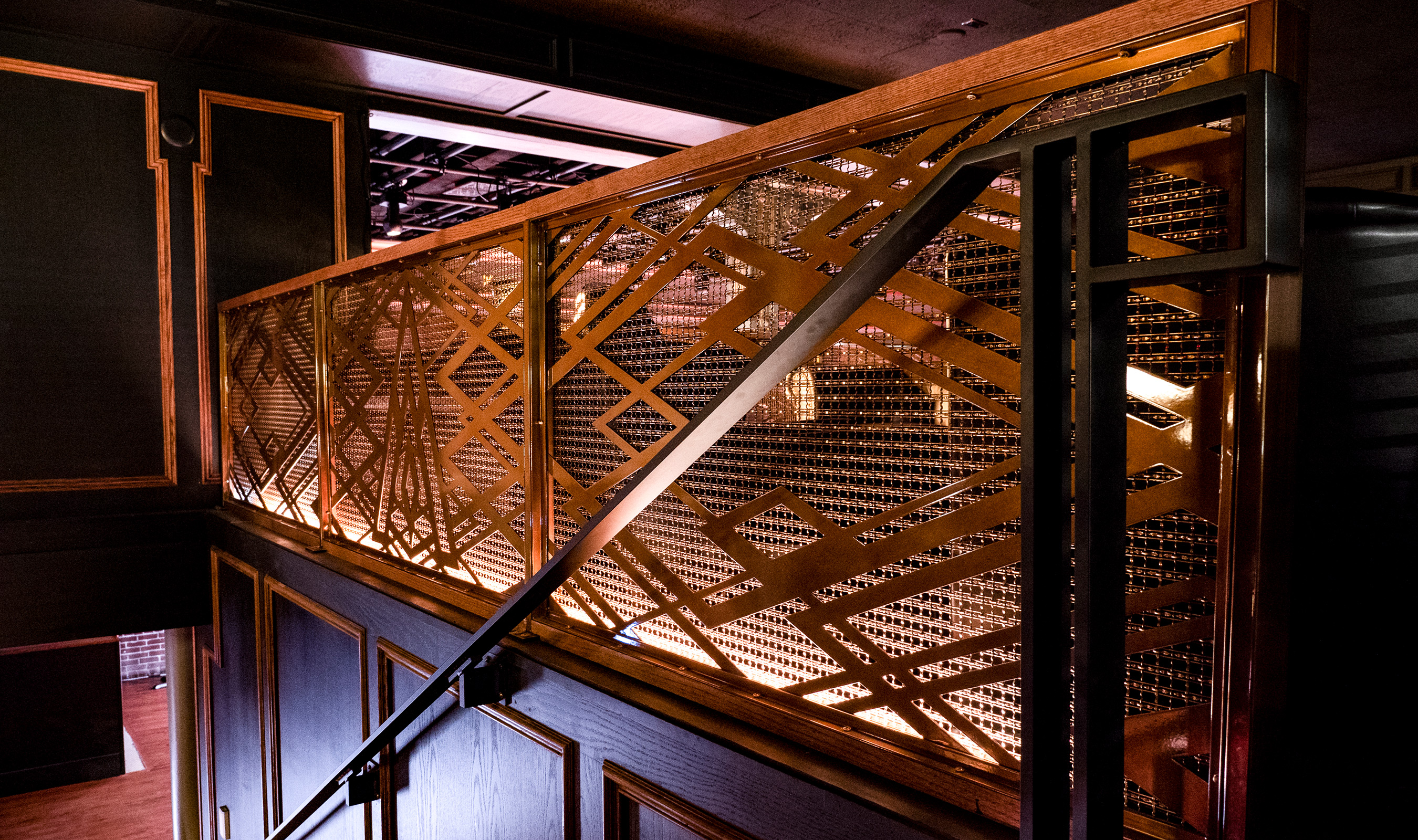 Decorative wire mesh is used as railing infill at the No Vacancy Lounge in Portland, OR.