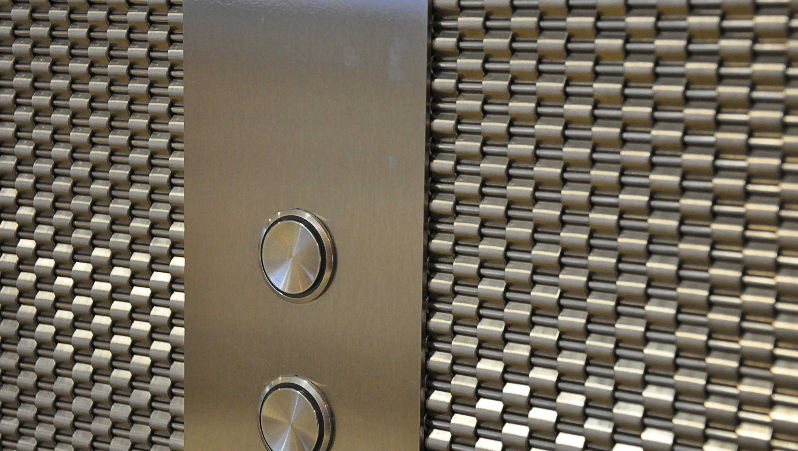 After consulting with Banker Wire, designers selected DS-1 woven wire mesh for the space.