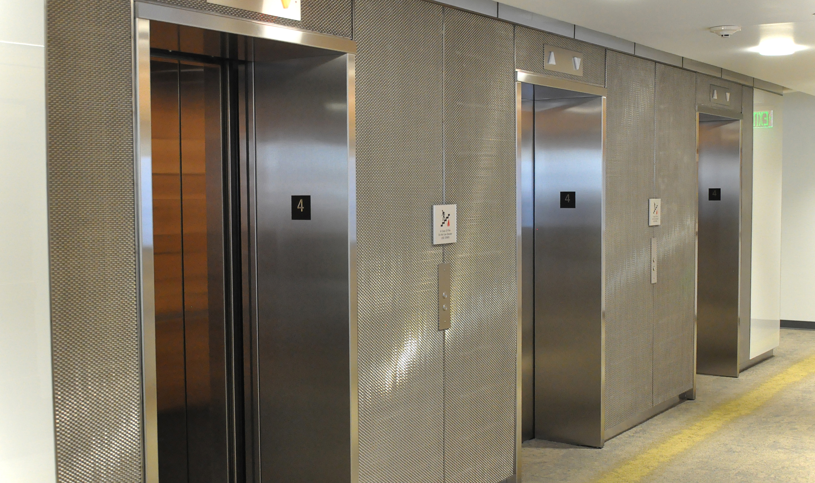Banker Wire metal fabric was incorporated around the elevator openings and control panels, blending a stylish look with full functionality.