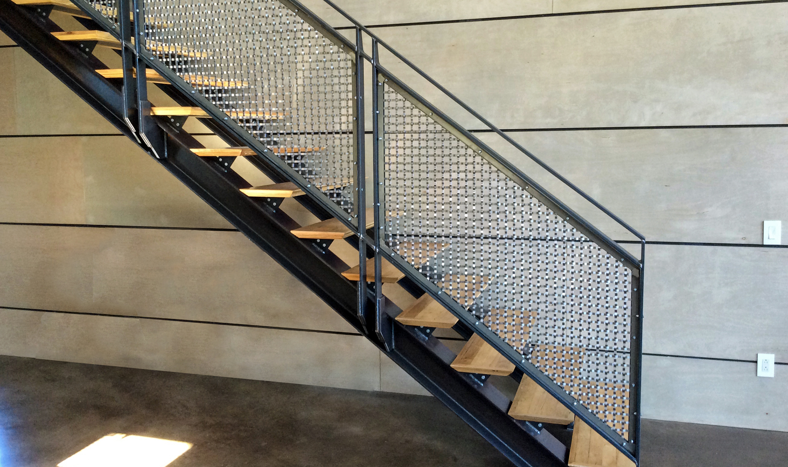 Stainless steel S-15 flat wire mesh pattern was framed using and angle and bar frame assembly.