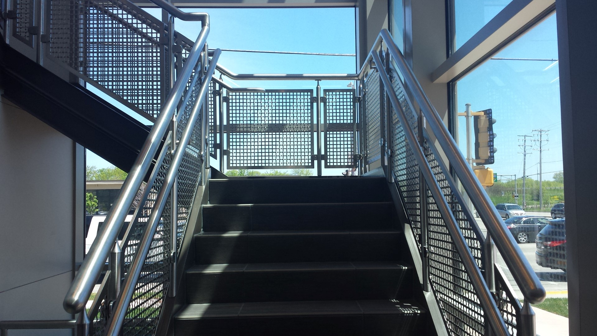 Banker Wire's S-15 flat woven wire mesh allows sunlight to filter throughout this space.