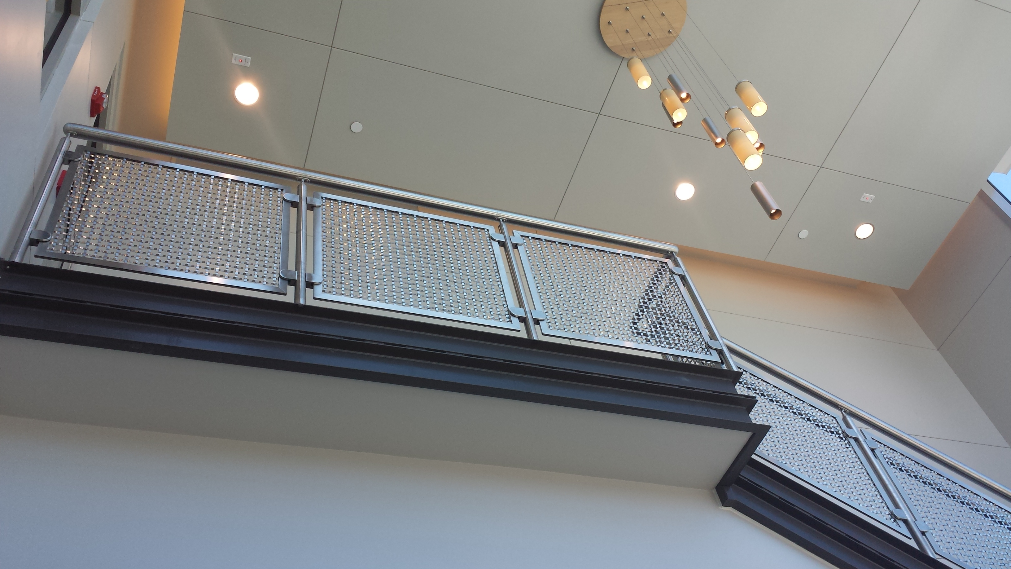Standard glass clips were used in the mounting of this S-15 architectural mesh and Versatile Spine frame.