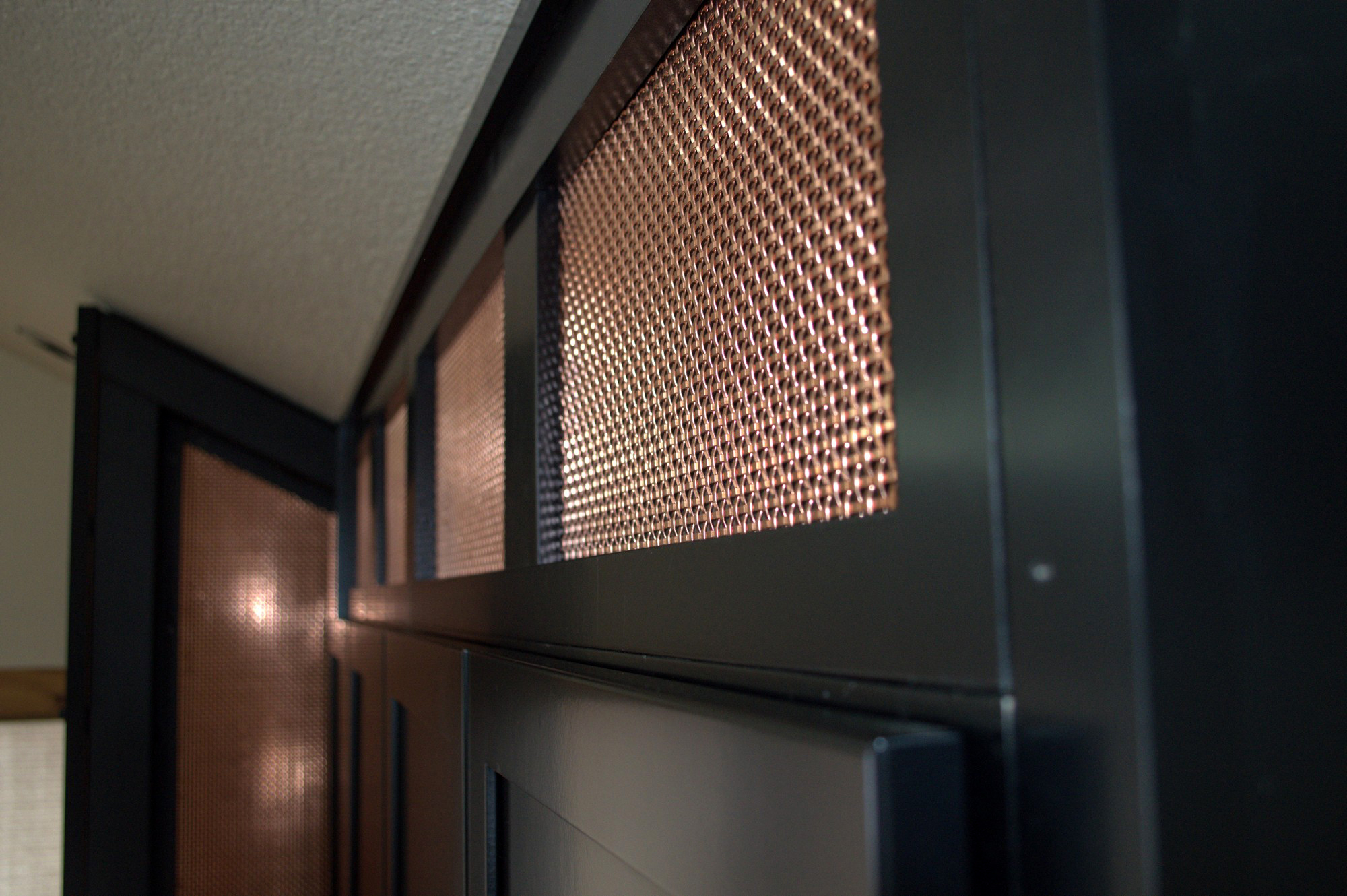 The flats of the crimped wire give this architectural wire mesh a reflective surface.