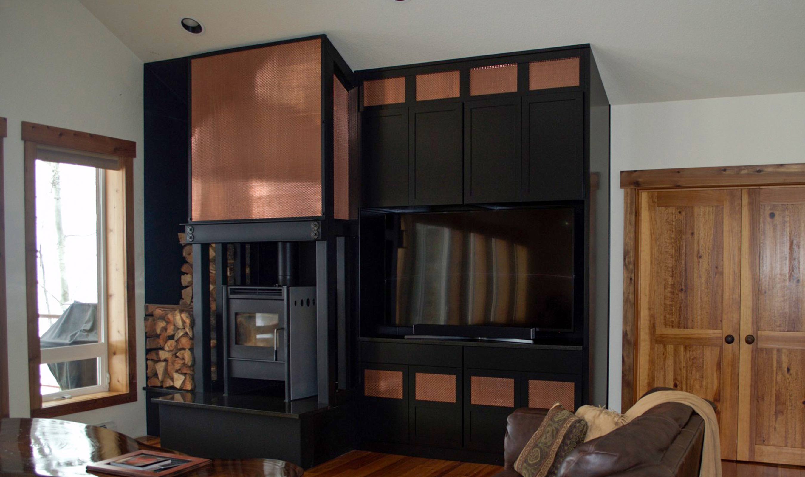 The shape of the wires used in the S-16 pattern move the viewer's eye around the attractive fireplace and entertainment center.