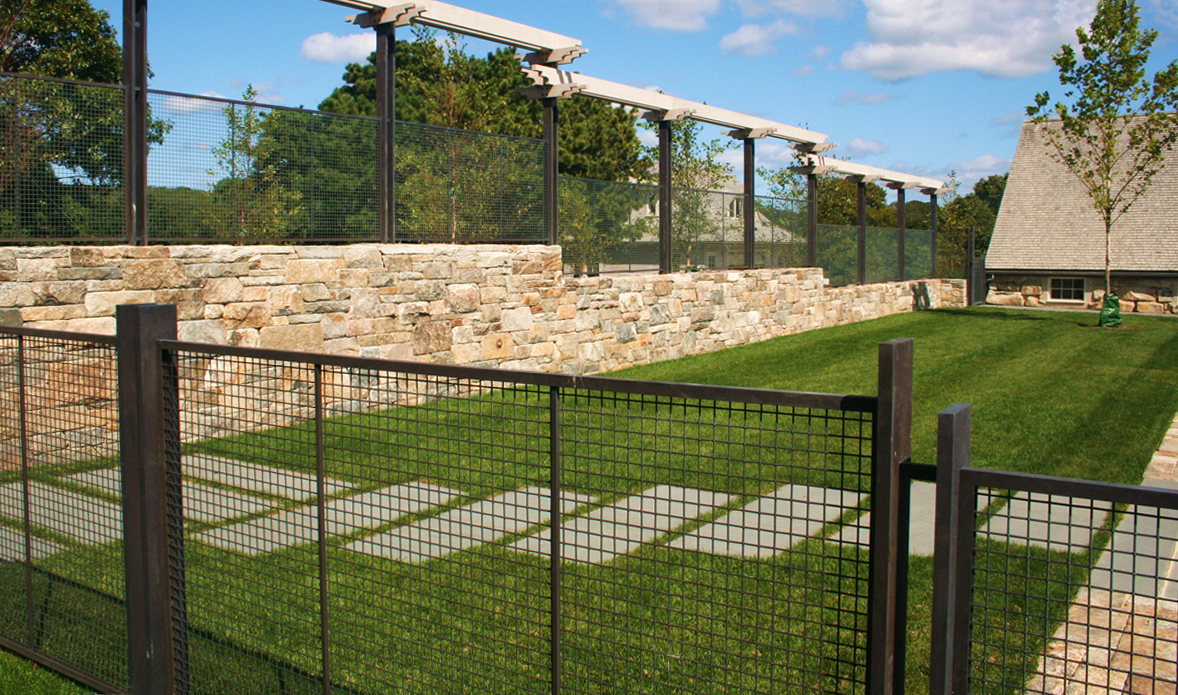 The woven wire mesh fence satisfies code and looks beautiful.
