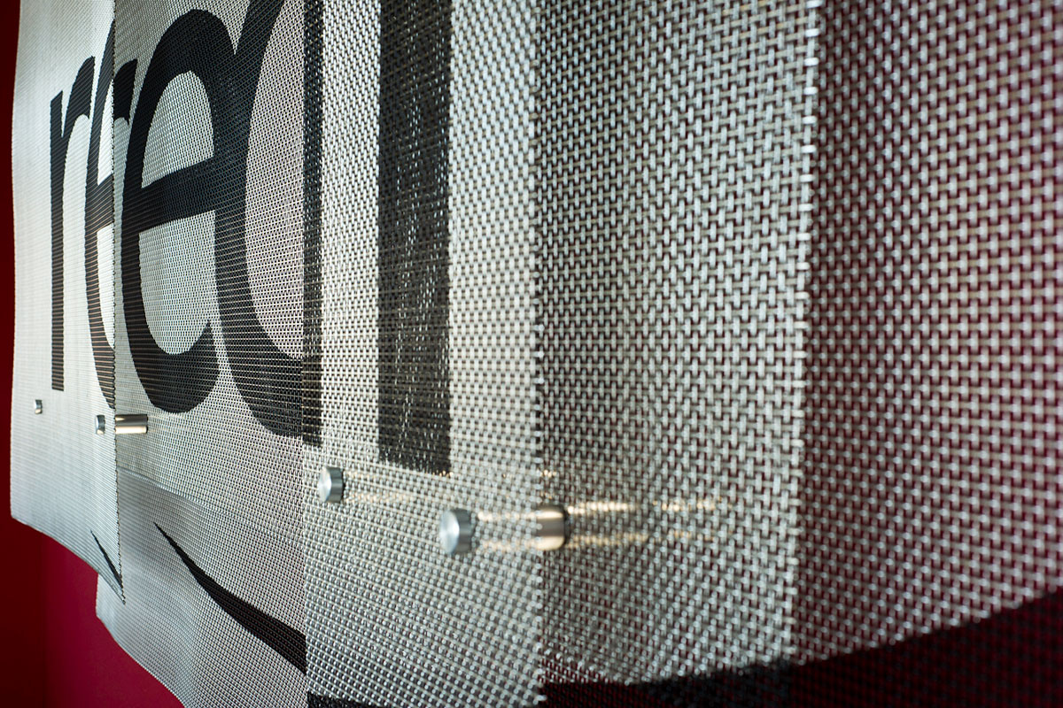 Woven wire mesh provides depth and an installation that changes depending on viewer angles.