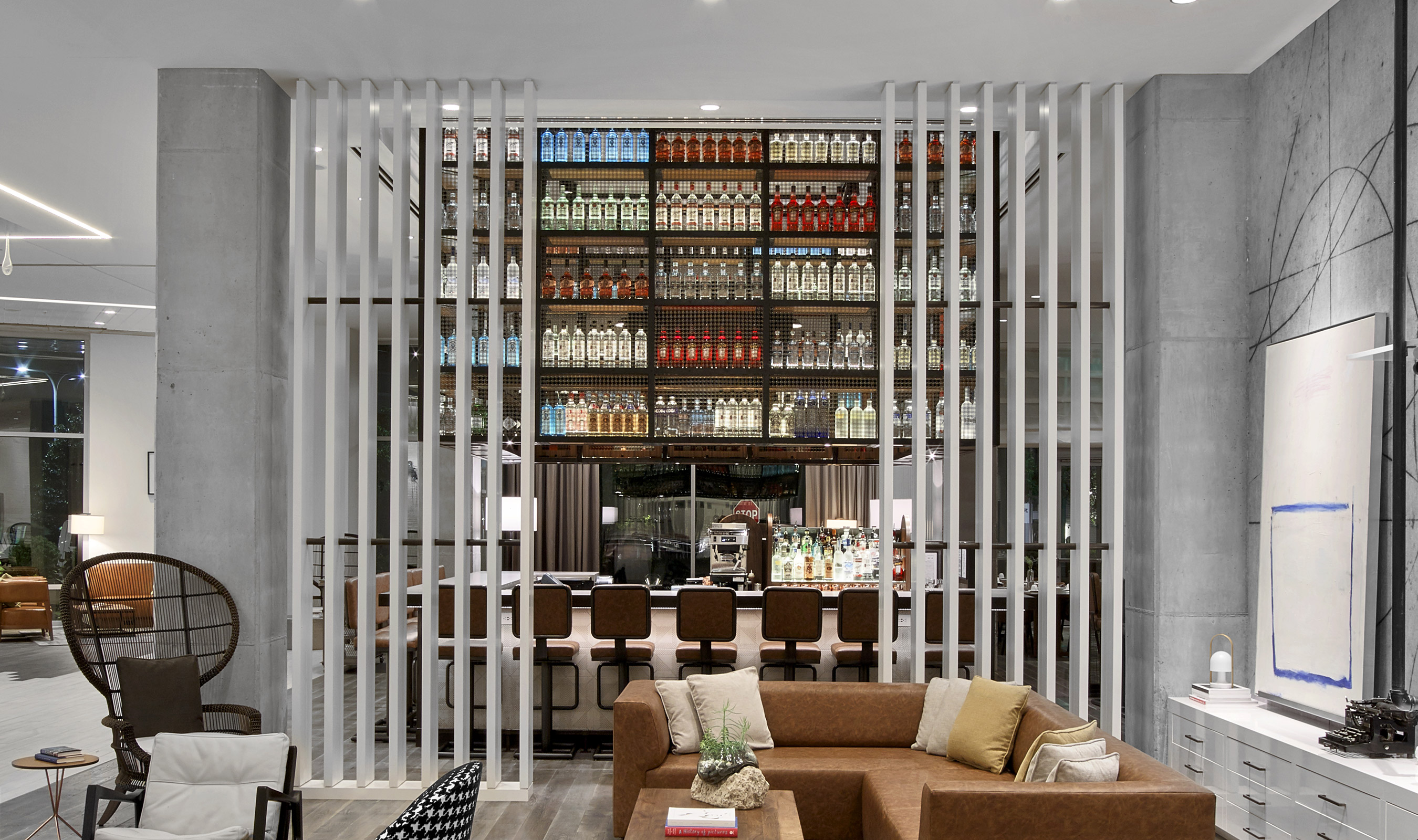 """The focal point of the bar area is the incredible """"floating"""" liquor cabinet that is as functional as it is striking."""