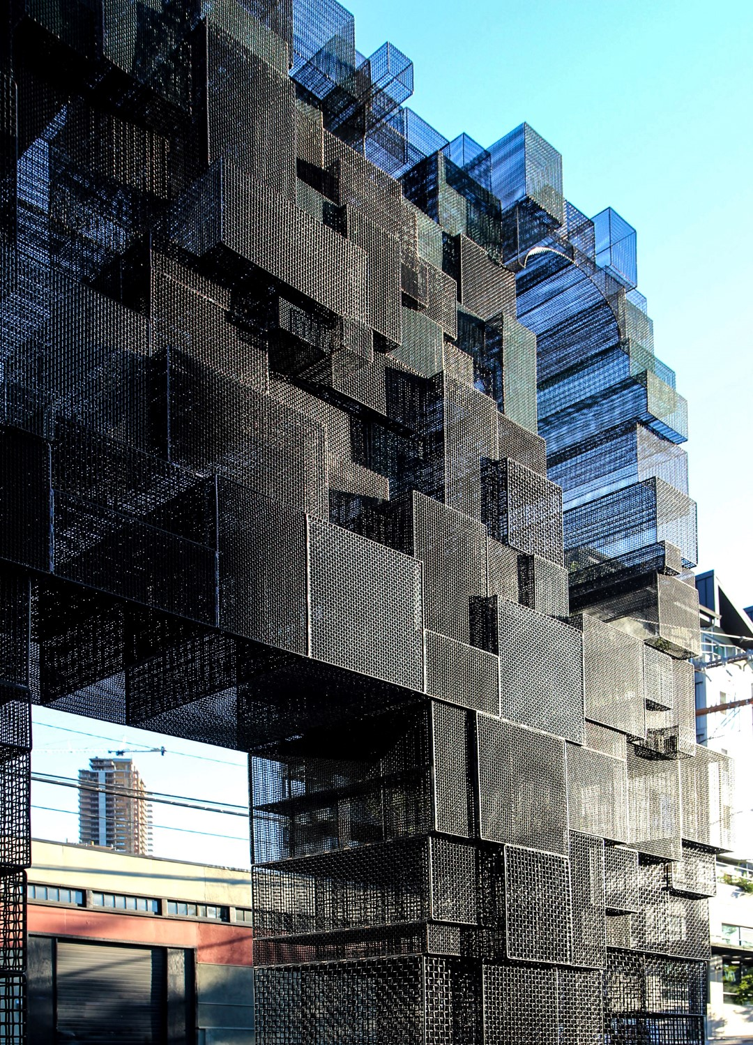 Nine different Banker Wire mesh patterns were used to introduce an urban street edge to the setback plaza where the sculpture sits.