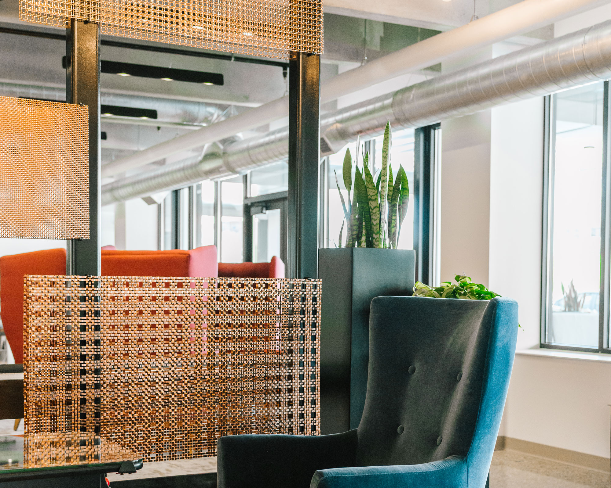 Copper plated panels of M22-22, M33-5, and S-12 are carefully arranged to partition off the seating areas while still allowing tenants and guests uninterrupted sightlines